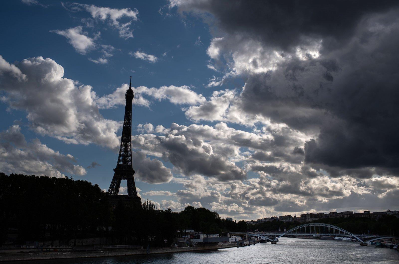 Seine river and the Eiffel Tower on a cloudy day on Labour Day (May Day) in Paris, on the 46th day of a lockdown aimed at curbing the spread of the COVID-19 pandemic, caused by the novel coronavirus on May 1, 2020. (AFP Photo)