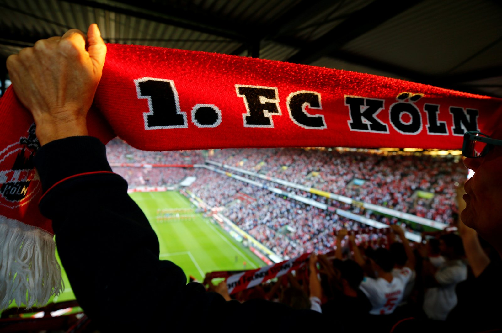 An FC Cologne fan displays her fan scarf at RheinEnergie stadium, in Cologne, Germany, Monday, Aug.13, 2018. (Reuters Photo)