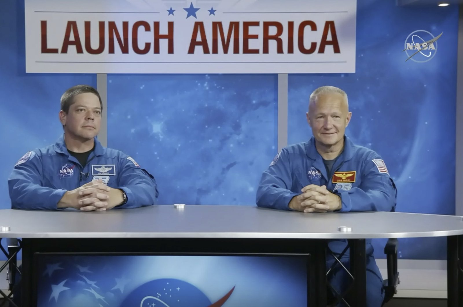 In this image from video made available by NASA, astronauts Bob Behnken, left, and Doug Hurley give a news conference at the Johnson Space Center in Houston on Friday, May 1, 2020. (AP Photo)