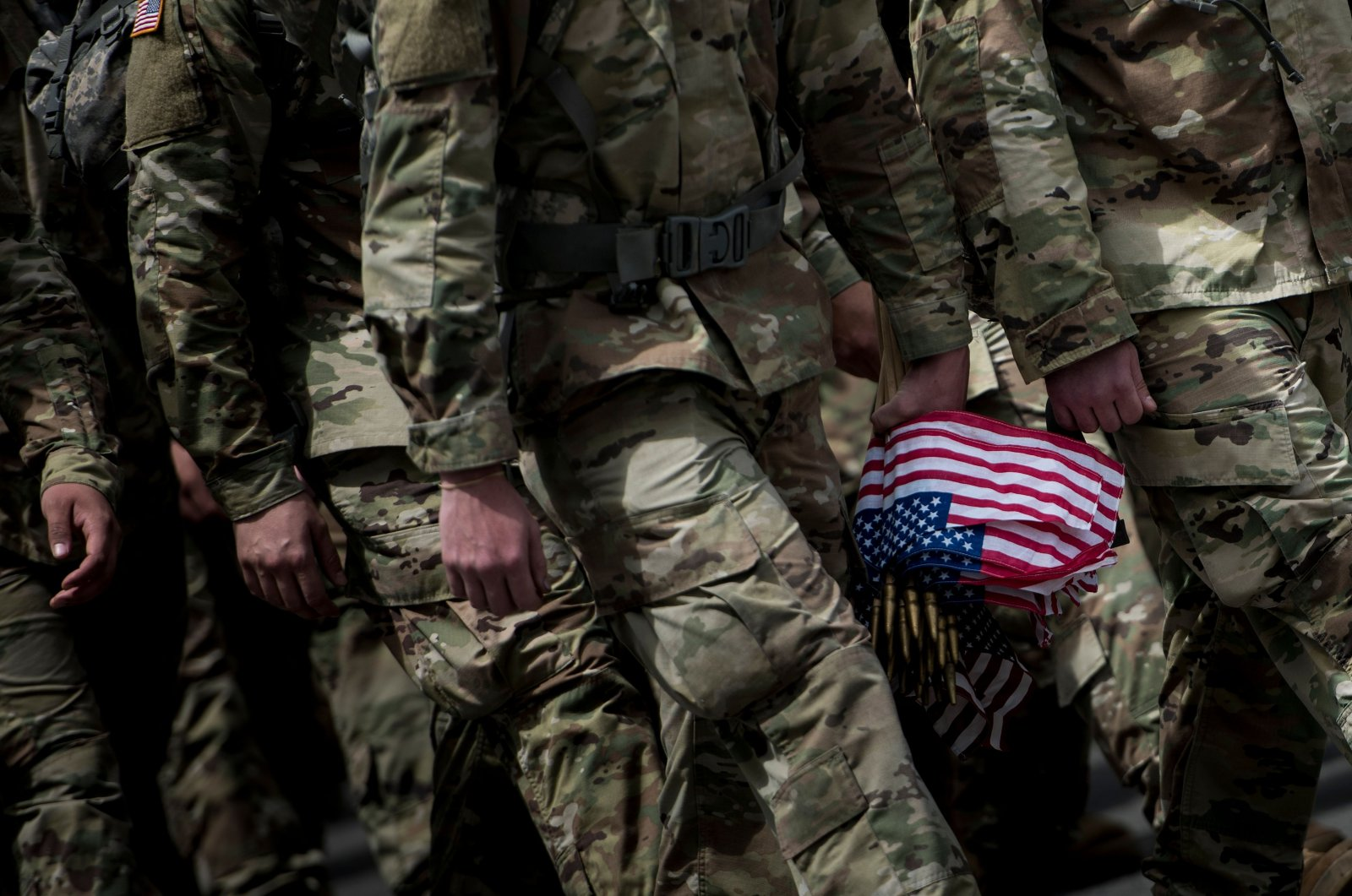 """Soldiers in the Old Guard arrive to place flags at graves in Arlington National Cemetery during """"Flags In"""" in preparation for Memorial Day in Arlington, Virginia on May 25, 2017. (AFP Photo)"""