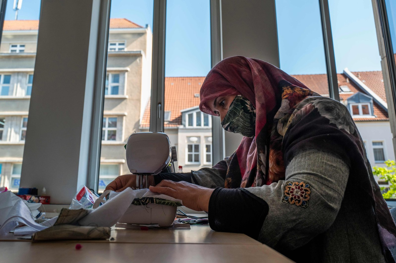 A refugee from Afghanistan sews face covers  amid the COVID-19 pandemic in Berlin, Germany on April 23, 2020. (AFP Photo)