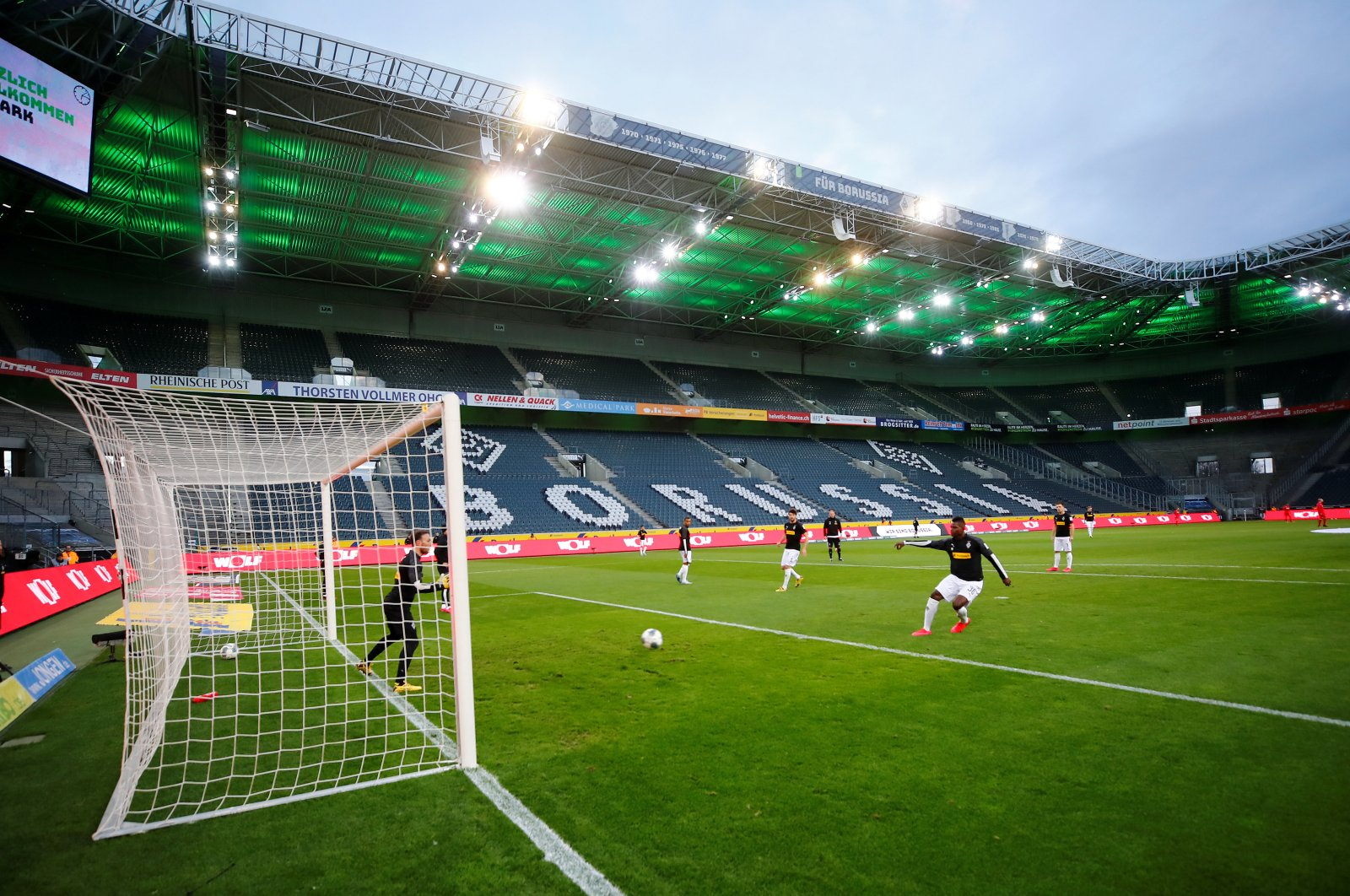 General view of Borussia players during the warm up before a match that was played behind closed doors on March 11, 2020 at Borussia-Park, Moenchengladbach, Germany. (Reuters Photo)