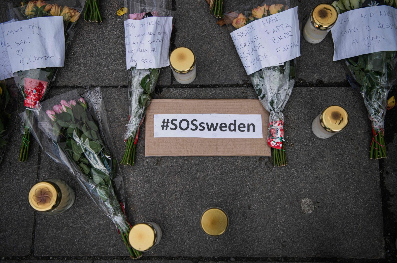 Picture taken on April 29, 2020 showing a memorial in Stockholm's Mynttorget Square to those lost to the new coronavirus. Many have voiced frustration over Sweden's softer approach to curbing the illness. (AFP Photo)