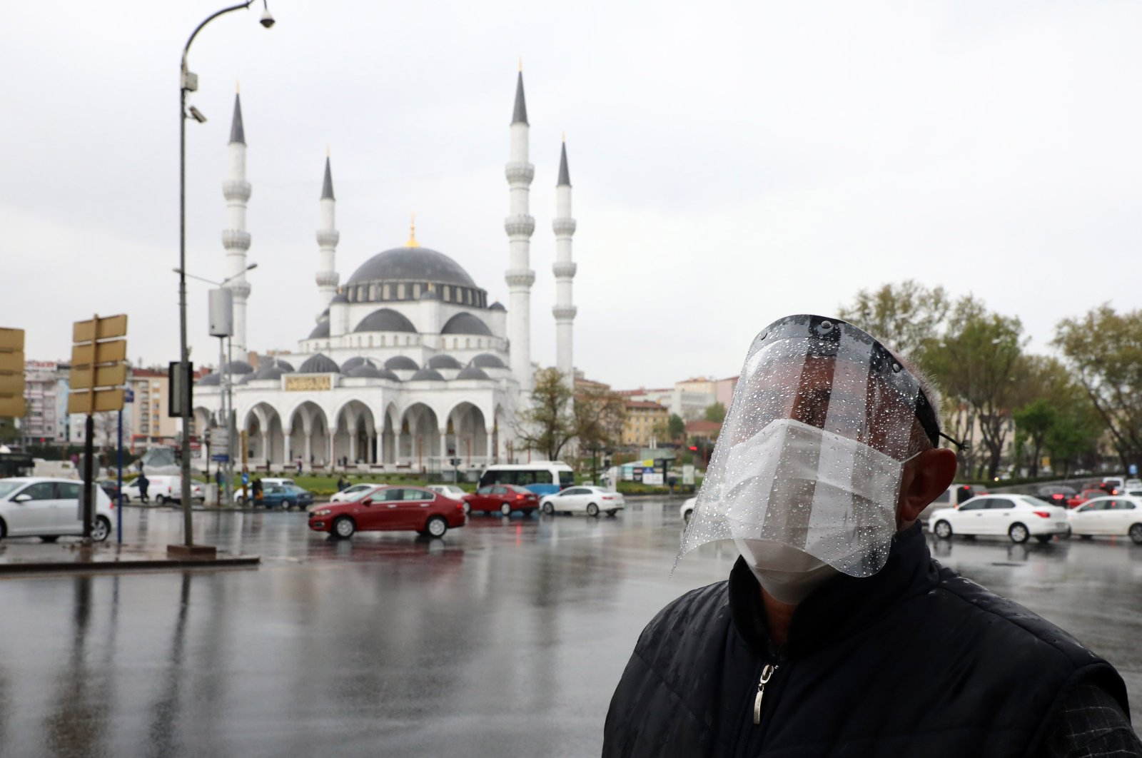 A man wearing a face-shield for protective measures crosses the streets as the spread of the COVID-19, the novel coronavirus continues in Ankara, on April 30, 2020. (AFP Photo)