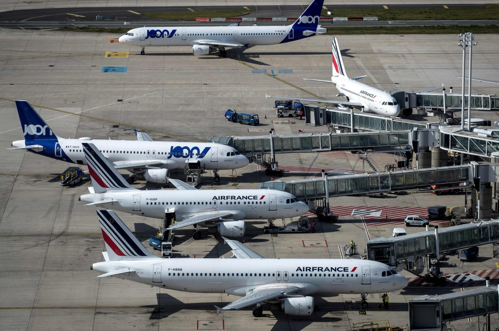 A picture taken on June 27, 2019 shows Air France and Joon (Air-France low cost company) Aibus and Boeing  parked  on the tarmac of Roissy-Charles de Gaulle Airport, north of Paris. (AFP Photo)