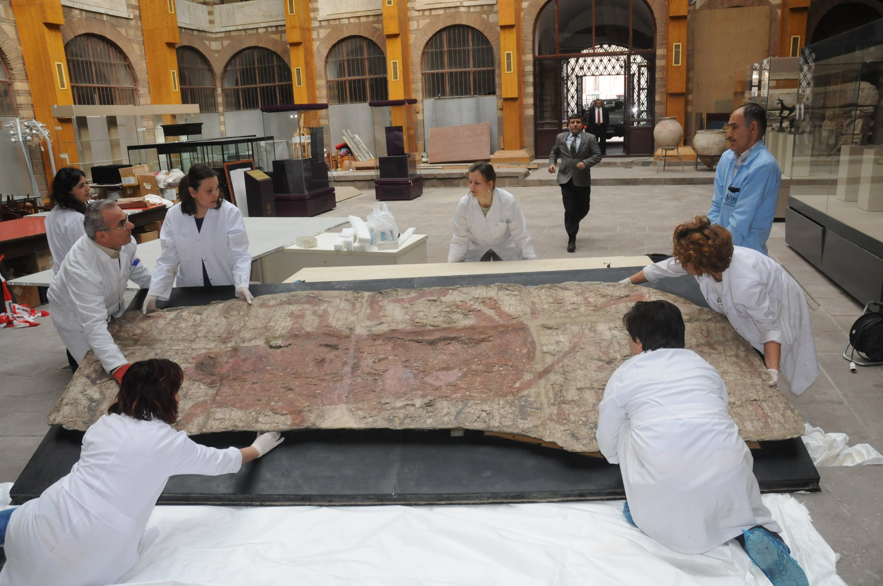 In this undated photo, a team of restorers deal with the conservation of a work from Çatalhöyük at the Ankara Restoration and Conservation Regional Laboratory. (AA Photo)