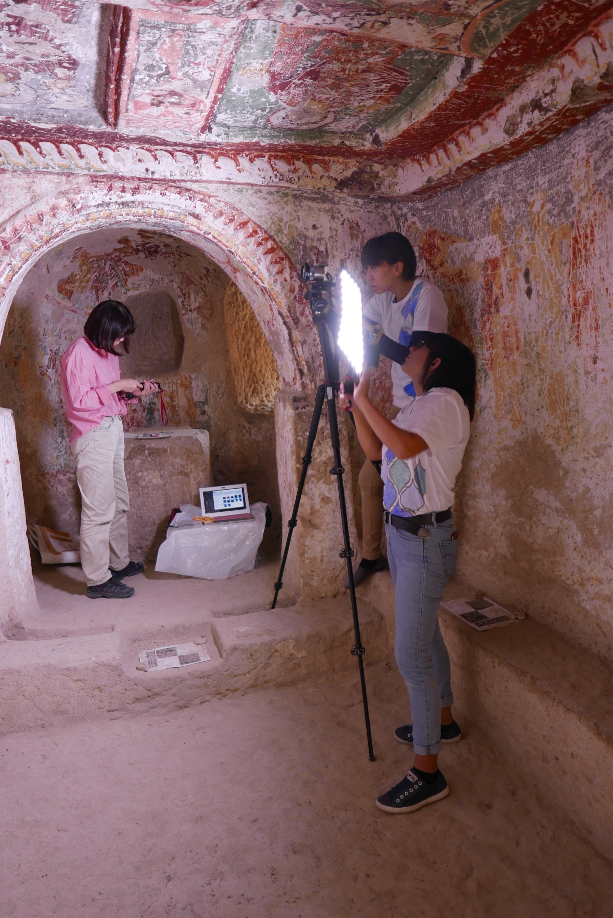 Restorers from Regional Directorate of Nevşehir Restoration and Conservation make documentation works for the wall paintings found in fairy chimneys. (AA Photo)