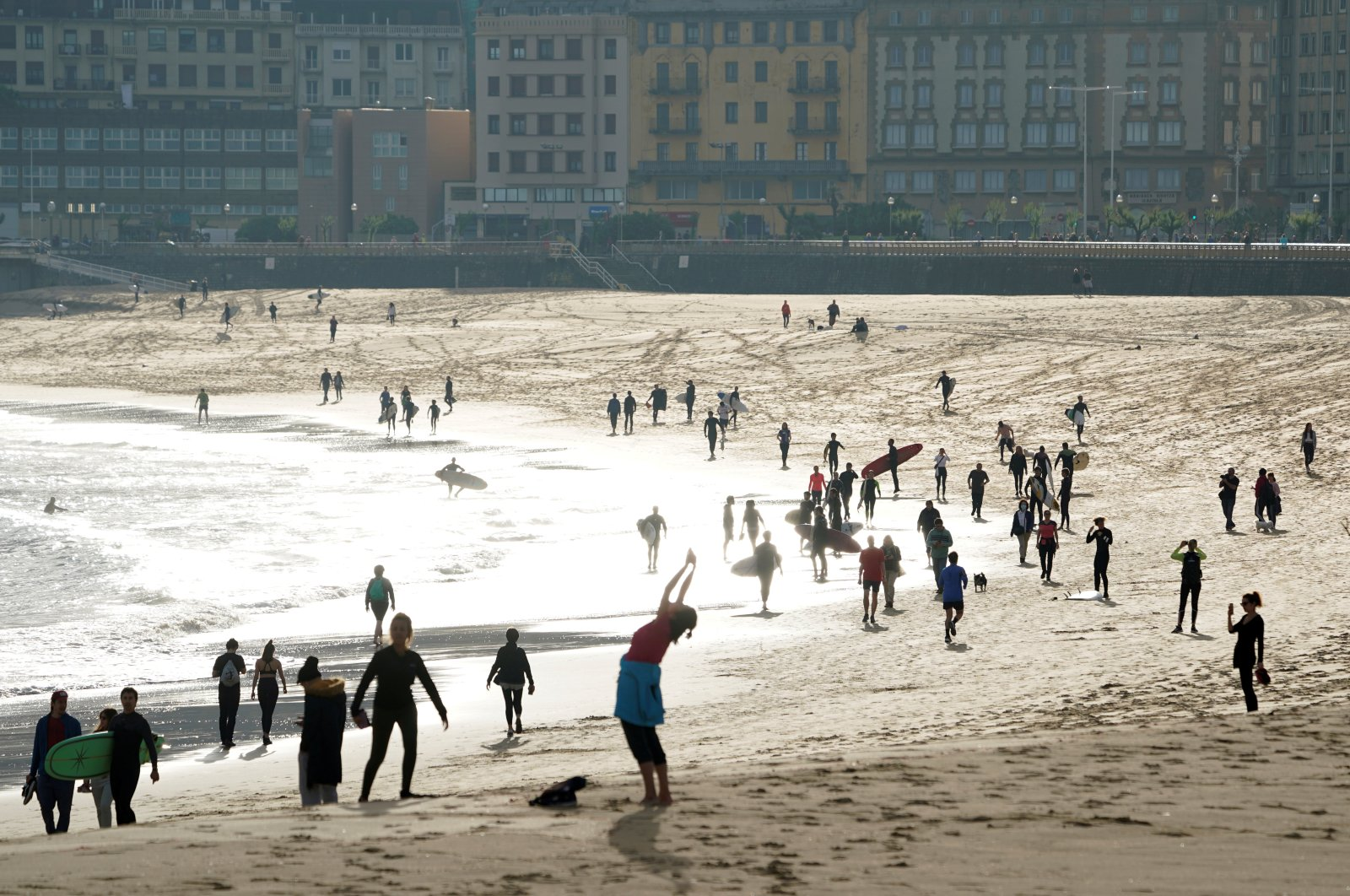 People exercise at Zurriola beach after adults were allowed out to exercise for the first time in seven weeks, as the government began easing coronavirus disease (COVID-19) restrictions, in San Sebastian, Spain, May 2, 2020.(REUTERS Photo)