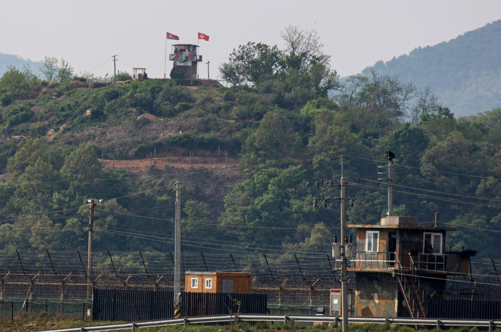 A North Koren frontier post (top) and a South Korean frontier post (front) face each other across the inter-Korean border near the city of Paju, Gyeonggi-do, South Korea, May 3 2020. (EPA Photo)