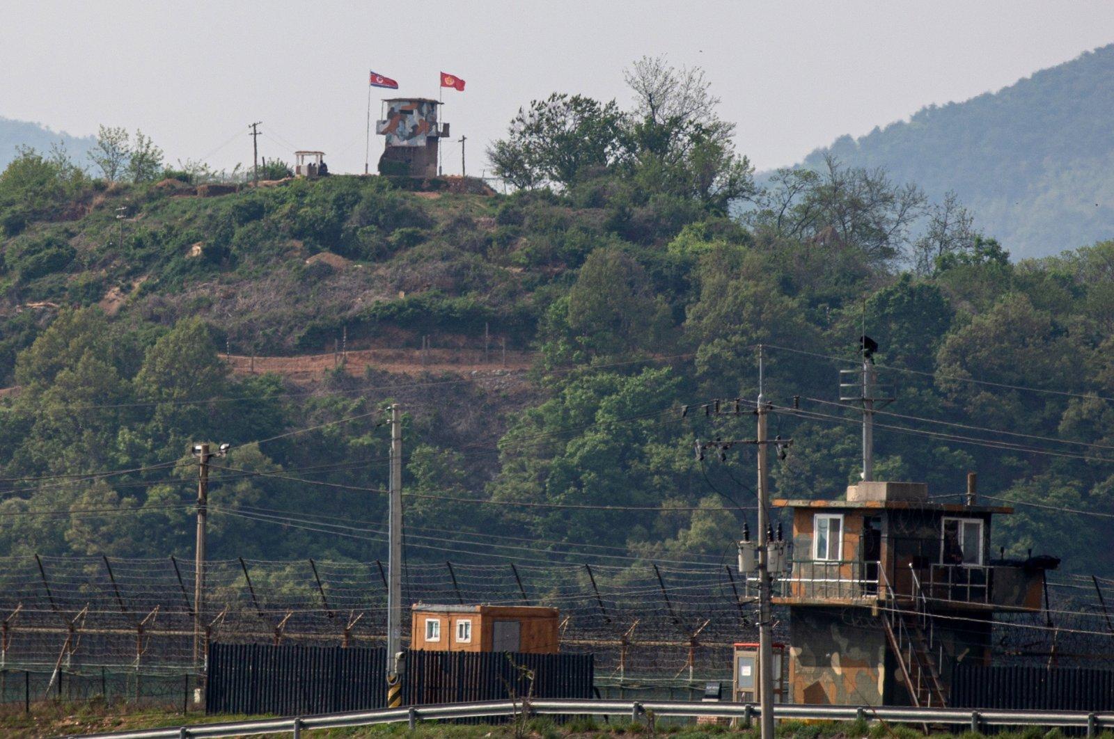 A North Koren frontier post (top) and a South Korean frontier post (front) face each other across the inter-Korean border near the city of Paju, Gyeonggi-do, South Korea, May 3 2020. (EPA Photo)