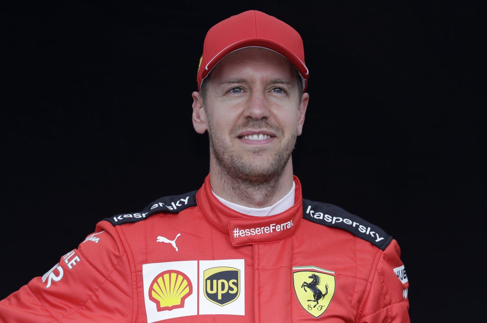 Ferrari's Sebastian Vettel poses for a photo at the Australian Grand Prix in Melbourne, March 12, 2020. (AP Photo)