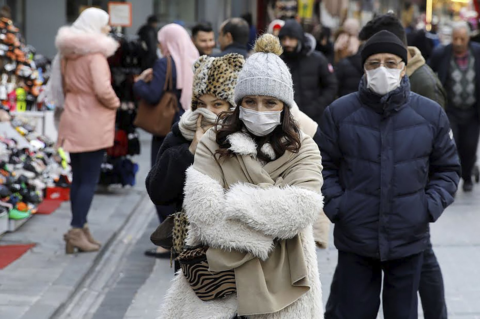 People wear protective face masks due to coronavirus concerns in Istanbul, Turkey, March 16, 2020. REUTERS