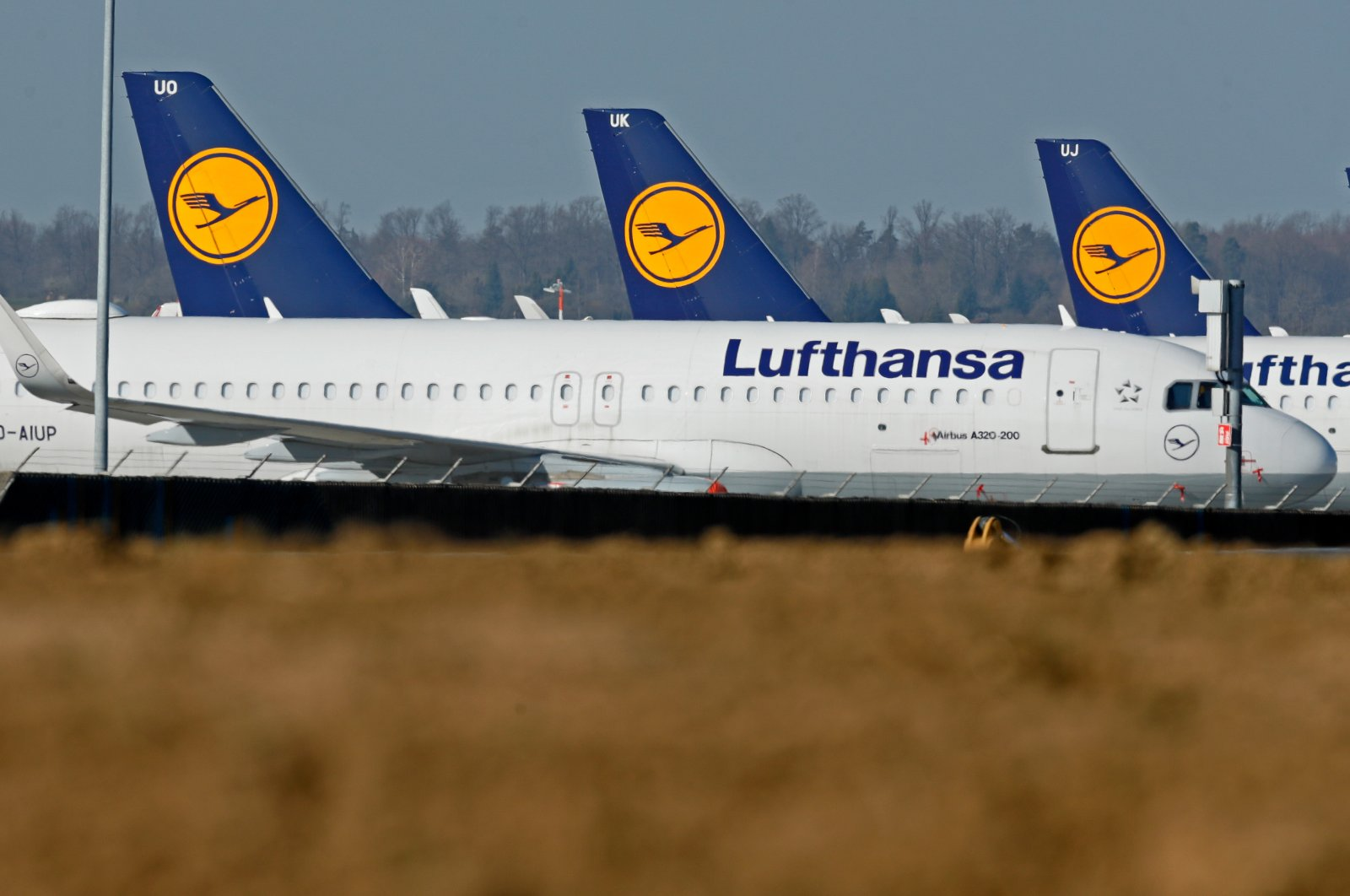 Aircrafts from German air carrier Lufthansa sit on blocks at the international airport in Stuttgart, Germany, April 6 2020. (EPA Photo)