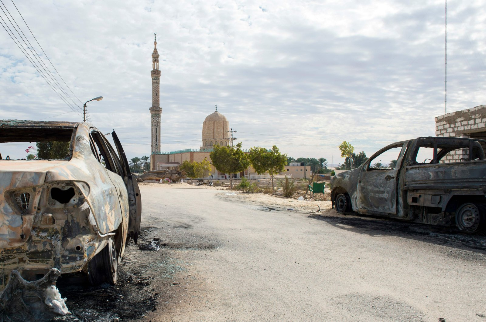 A picture taken on November 25, 2017, shows the Rawda mosque, roughly 49 kilometres west of the north Sinai capital of El-Arish, after a gun and bombing attack armed attackers killed at least 235 worshippers in a bomb and gun assault on the packed mosque in Egypt's restive north Sinai province, in the country's deadliest attack in recent memory. (AFP Photo)