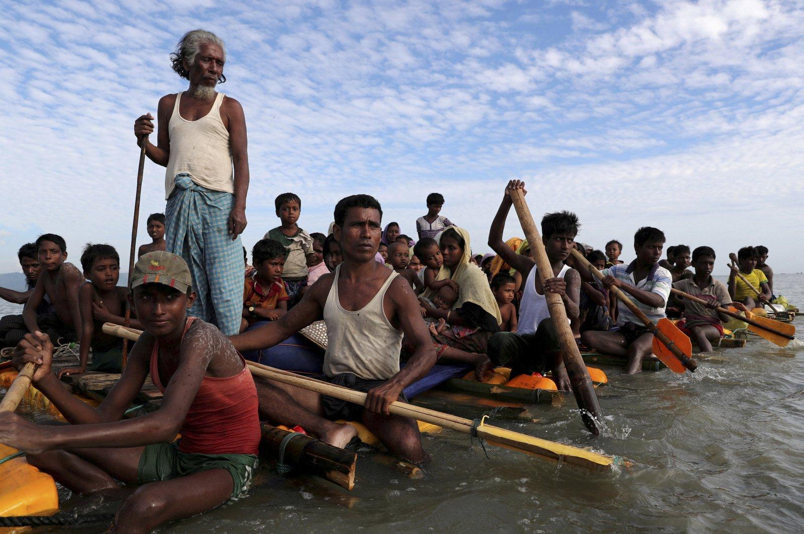 Rohingya refugees cross the Naf River with an improvised raft to reach to Bangladesh in Teknaf, Bangladesh, November 12, 2017. (Reuters Photo)