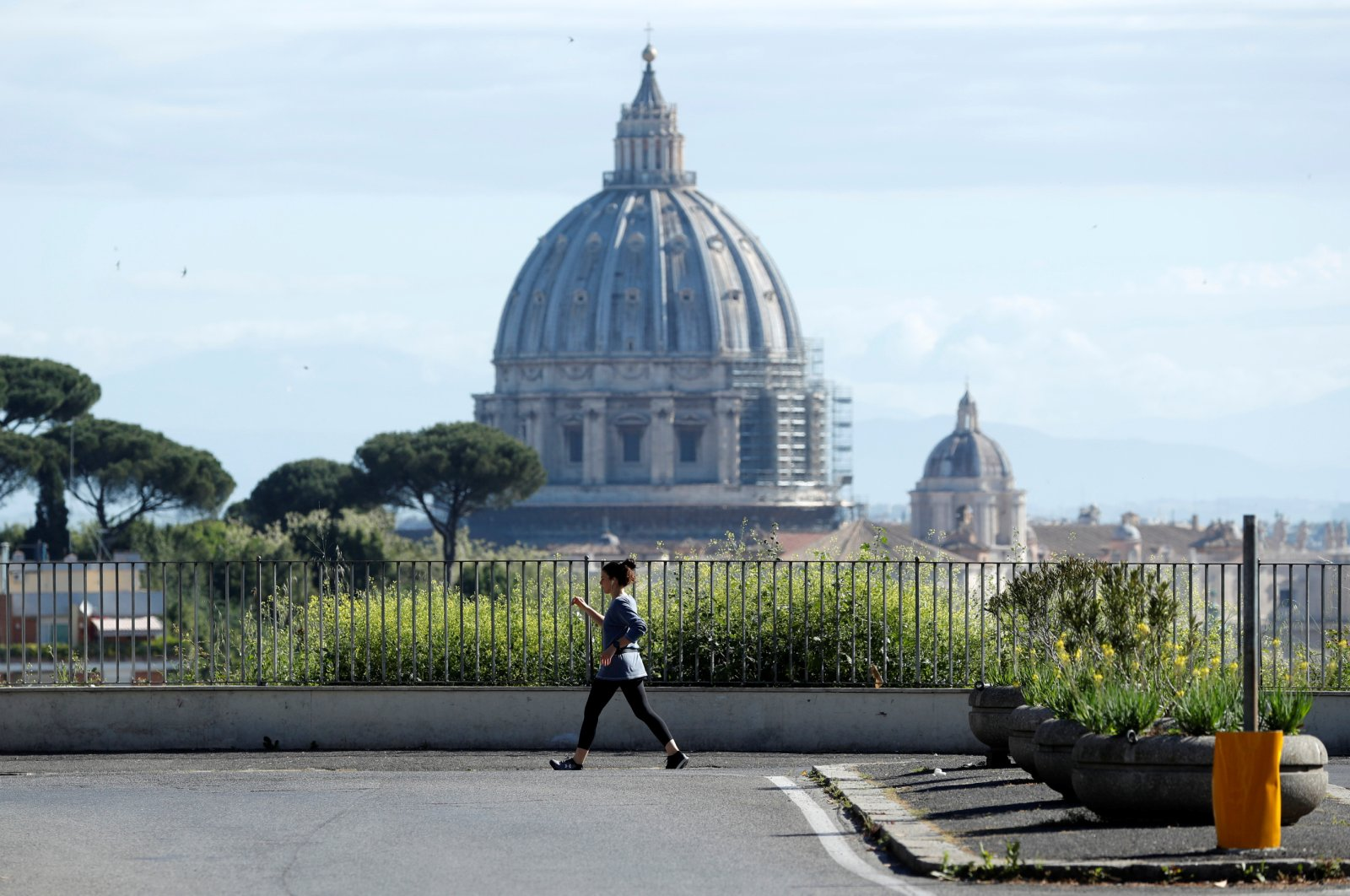 A woman walks with St. Peter's Basilica in the background, in Rome, Italy, May 3, 2020. (Reuters Photo)