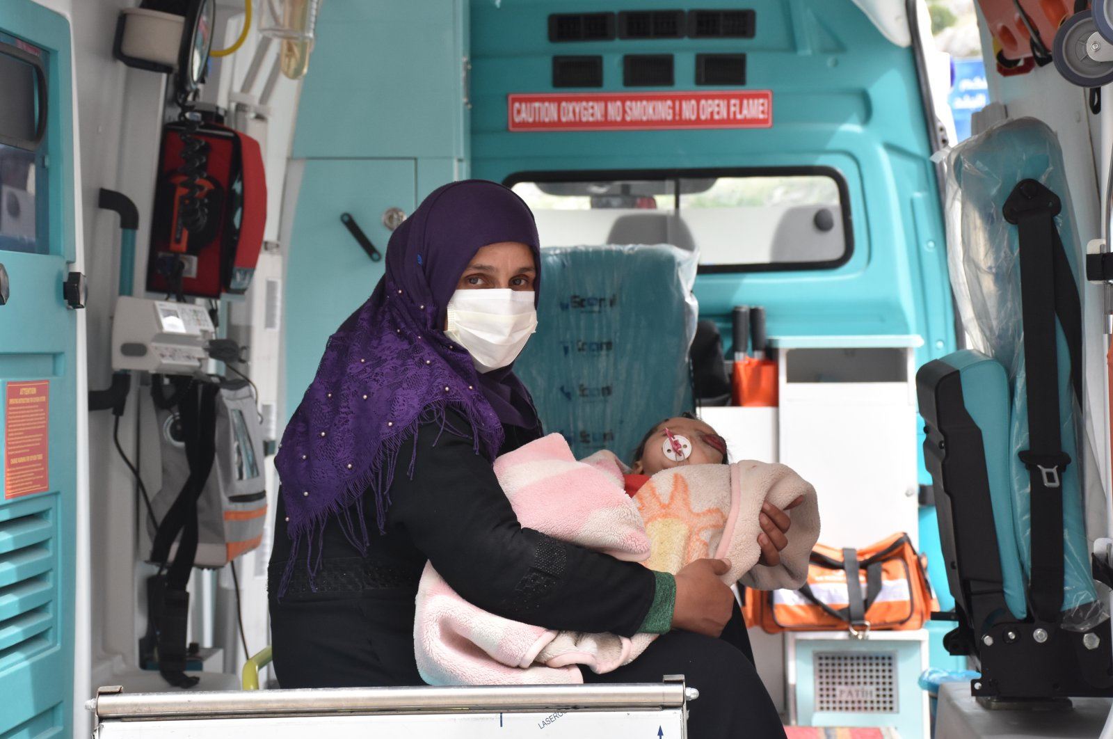 Yusuf and his mother ride in an ambulance sent by the Hatay Governorate to pick them up at the Cilvegözü Border Gate in the Reyhanlı district of Hatay, Turkey, May 3, 2020. (AA Photo)