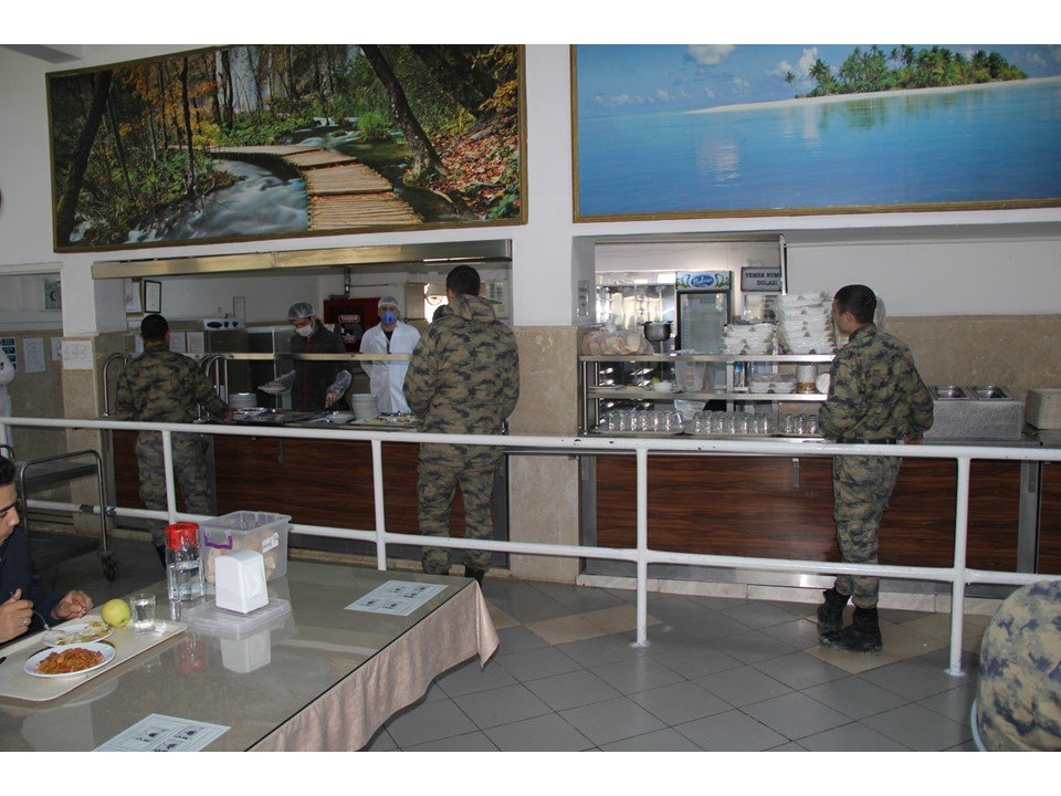 Turkish military soldiers wait in a food queue in a dining hall while keeping social distancing, May 3, 2020. (AA)