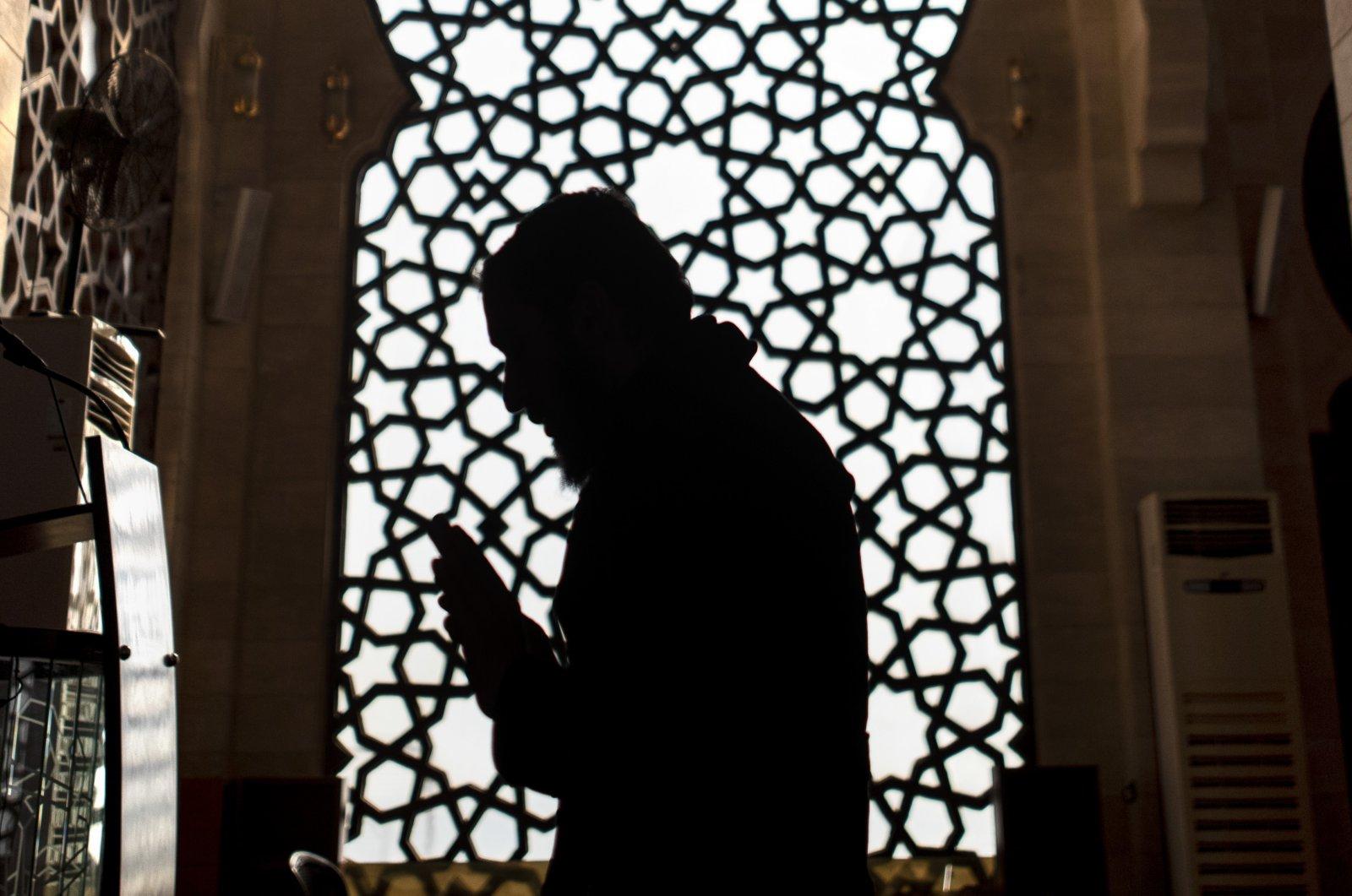 A Palestinian imam prays in a mosque during Ramadan, Gaza City, April 22, 2020. (AP Photo)