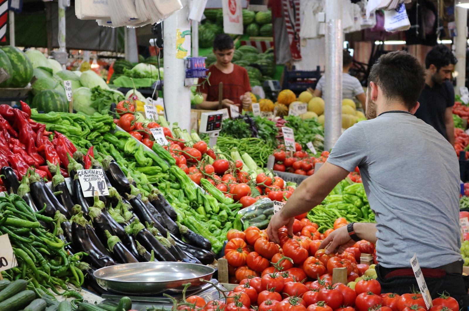 A seller arranges his produce at a bazaar in Turkey's Sivas, July 4, 2019. (Shutterstock Photo)