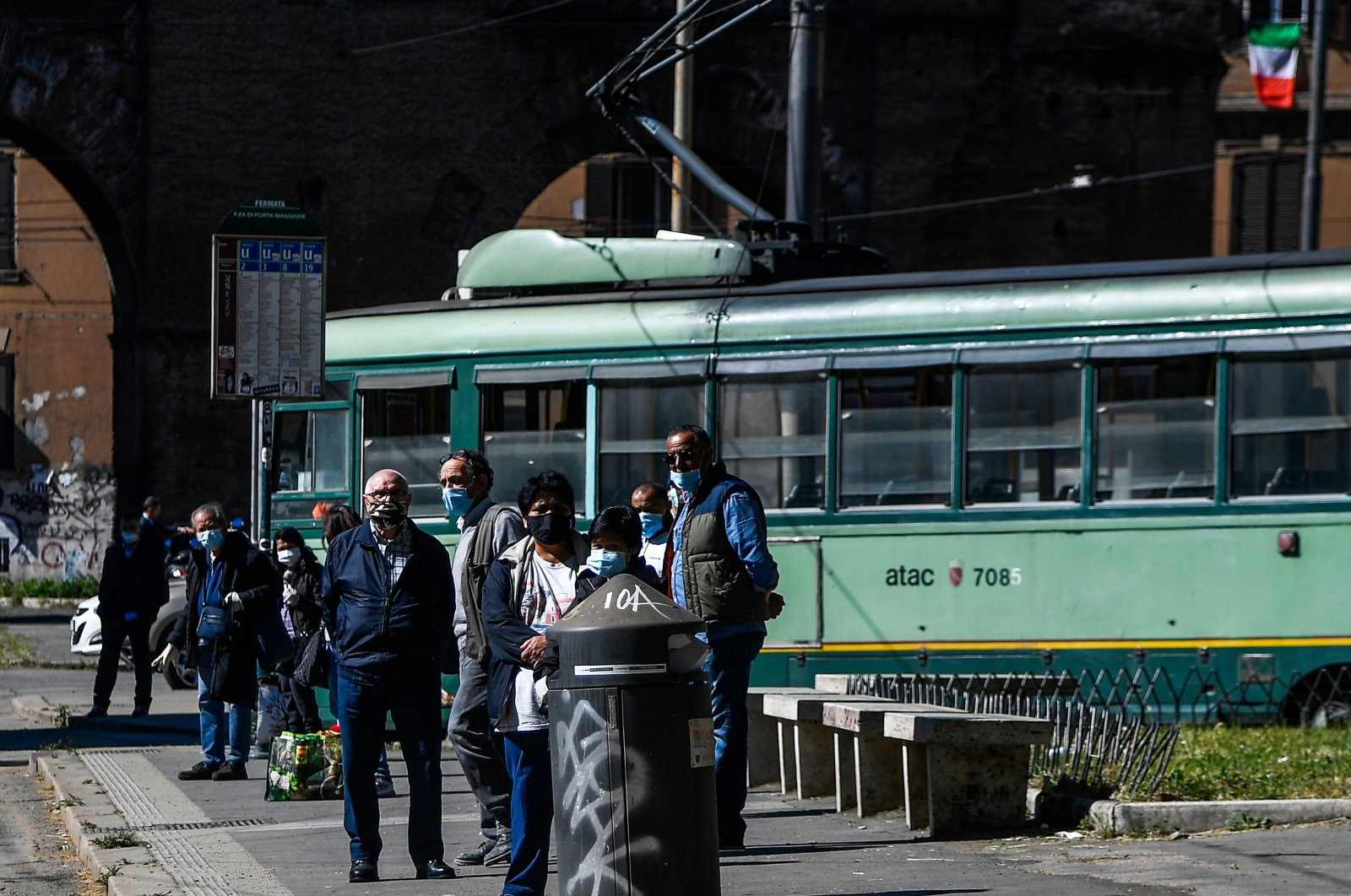 Commuters wait for the tramway at Porta Maggiore in Rome, as Italy starts to ease its lockdown aimed at curbing the spread of COVID-19, May 4, 2020. (AFP Photo)