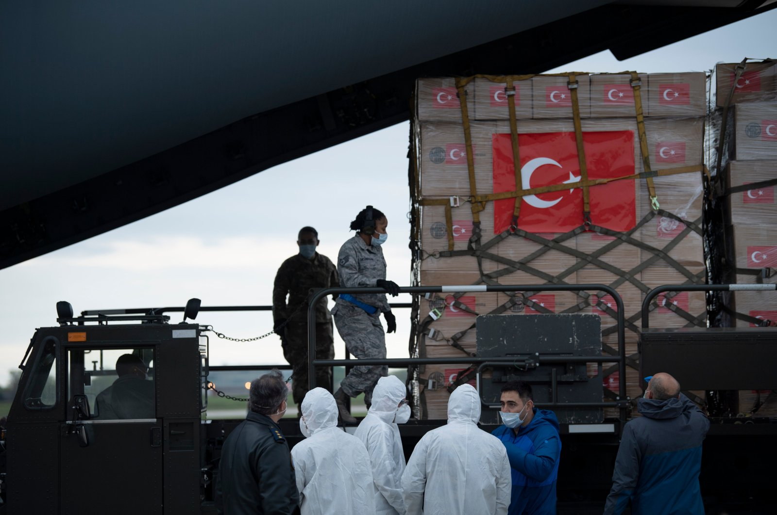 A Turkish military cargo plane with medical supplies and protective equipment to combat COVID-19 in the US is unloaded at Andrews Air Force Base, in Maryland, April 28, 2020. (AFP)