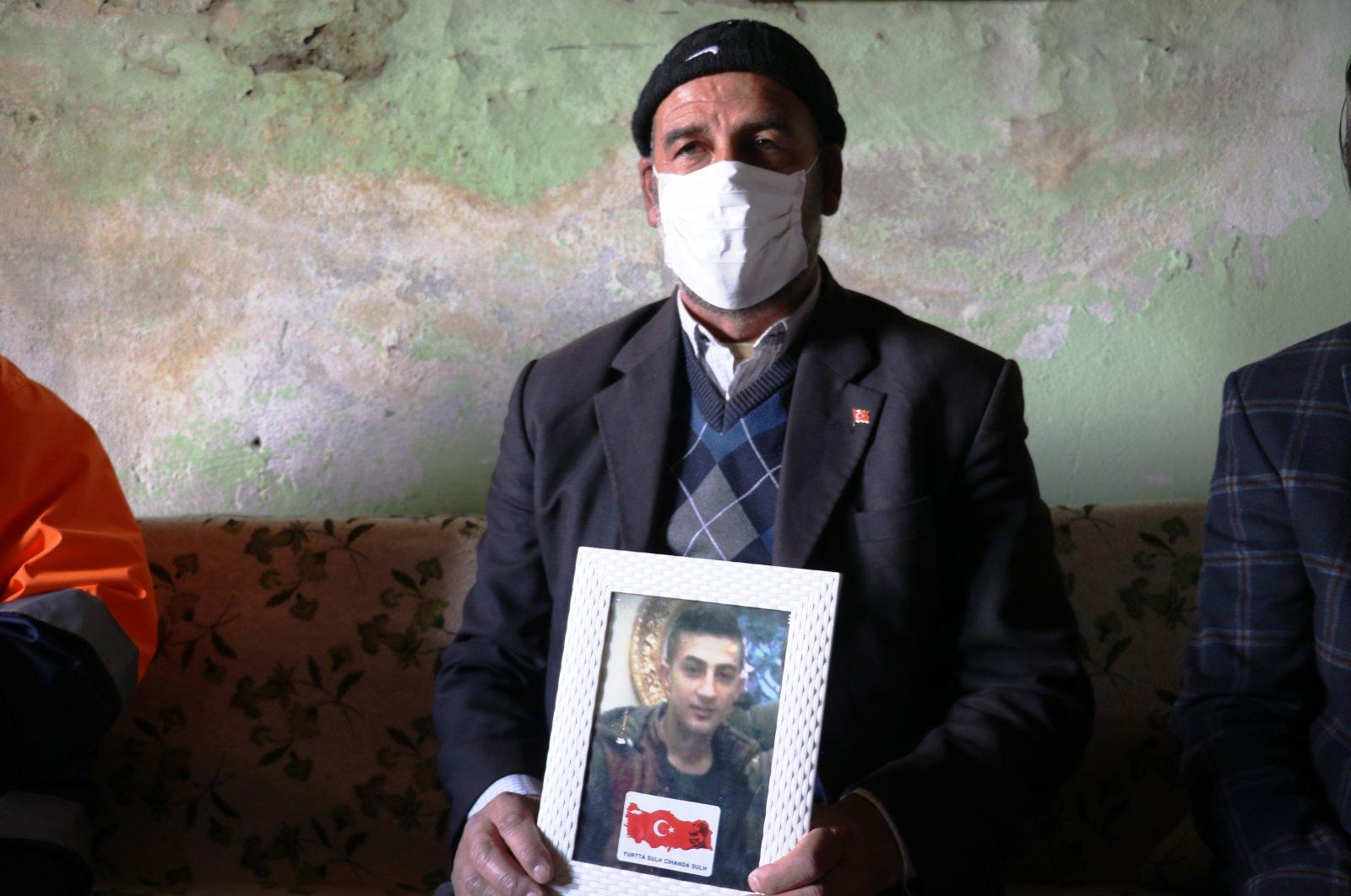 Salih Gökçe holds a photo of his son, who was kidnapped by PKK terrorists, Ağrı province, Turkey, May 3, 2020. (AA Photo)