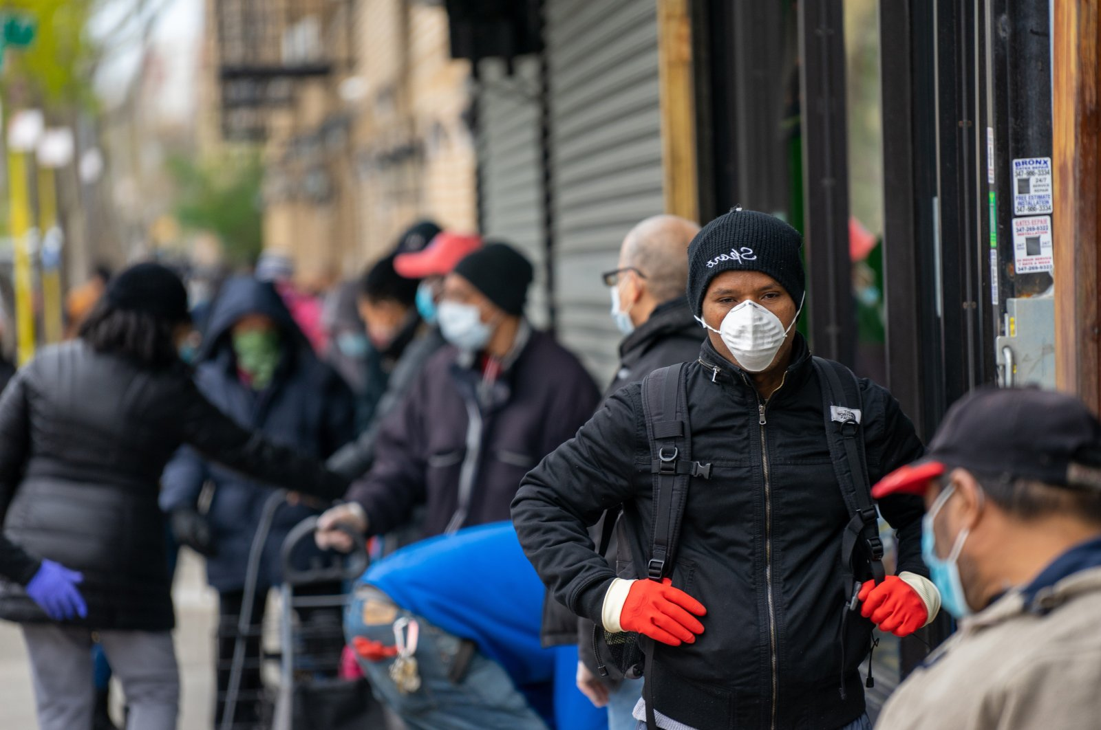 People wait in line for meals to be distributed at the Bronx Draft House on April 23, 2020, in the Bronx borough of New York City. (Getty Images)