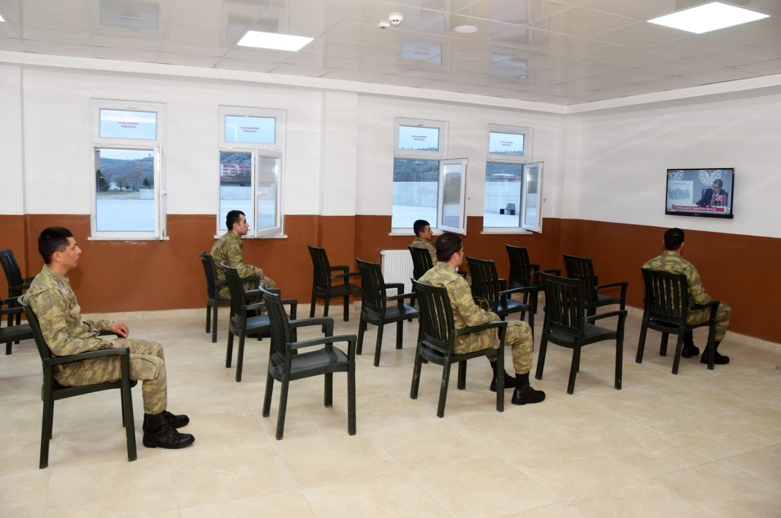 Turkish military soldiers watching TV in a military mess while keeping social distancing, May 3, 2020. (AA)