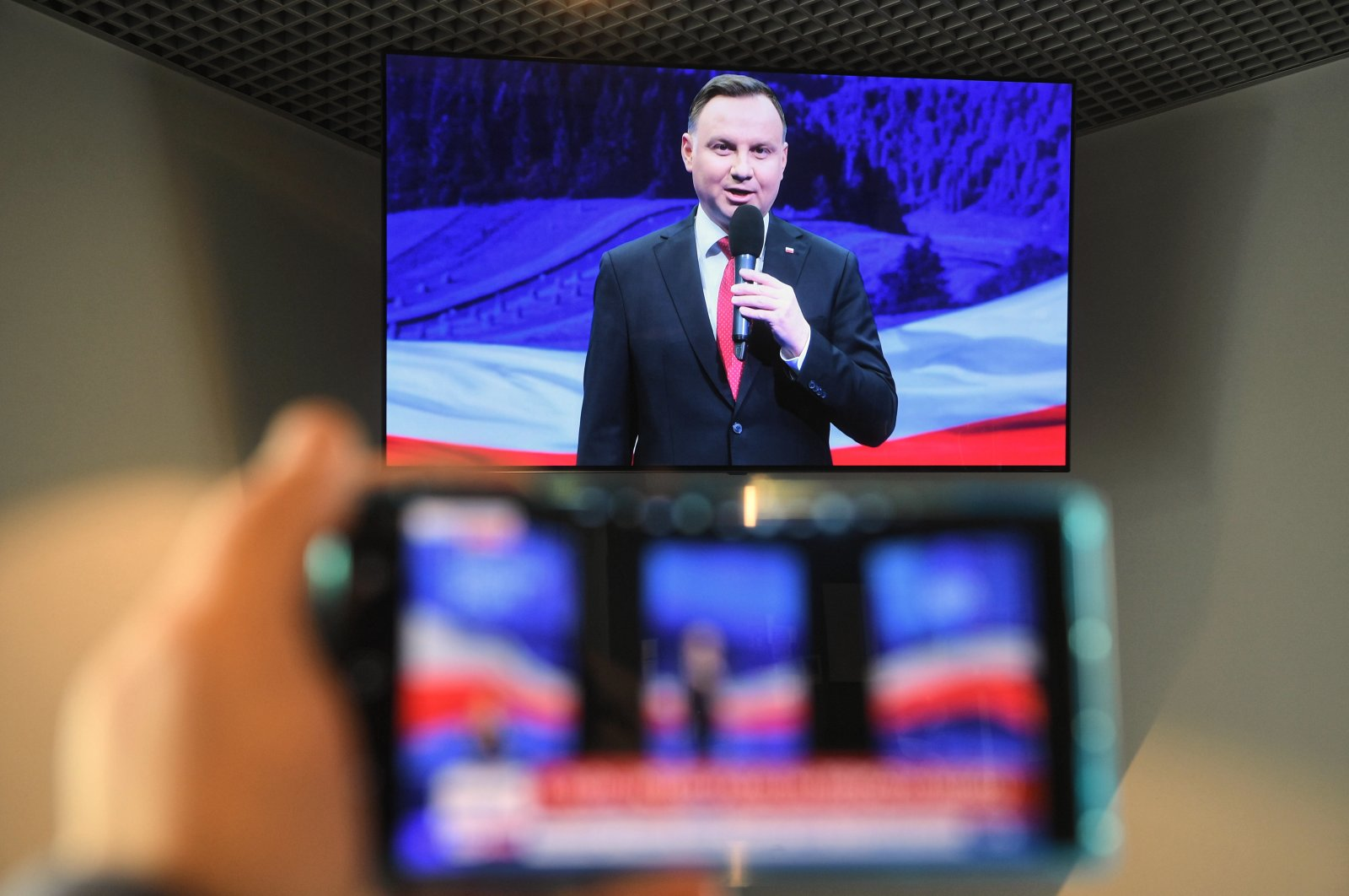 A television screen shows Polish President Andrzej Duda during the broadcast from the program convention in the village of Szeligi, Poland on May 1, 2020. (EPA Photo)