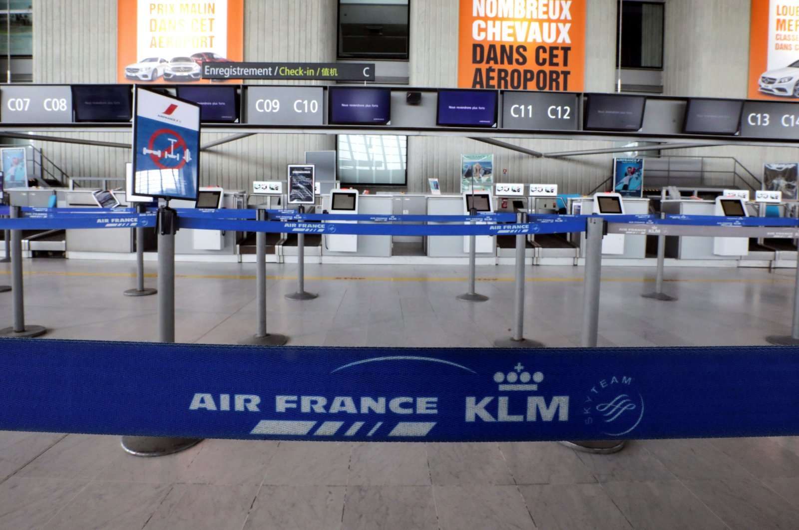 A view shows a deserted Air France check-in desk at Nice international airport, as a lockdown is imposed to slow the rate of the coronavirus disease (COVID-19), in Nice, France, April 13, 2020. (Reuters Photo)