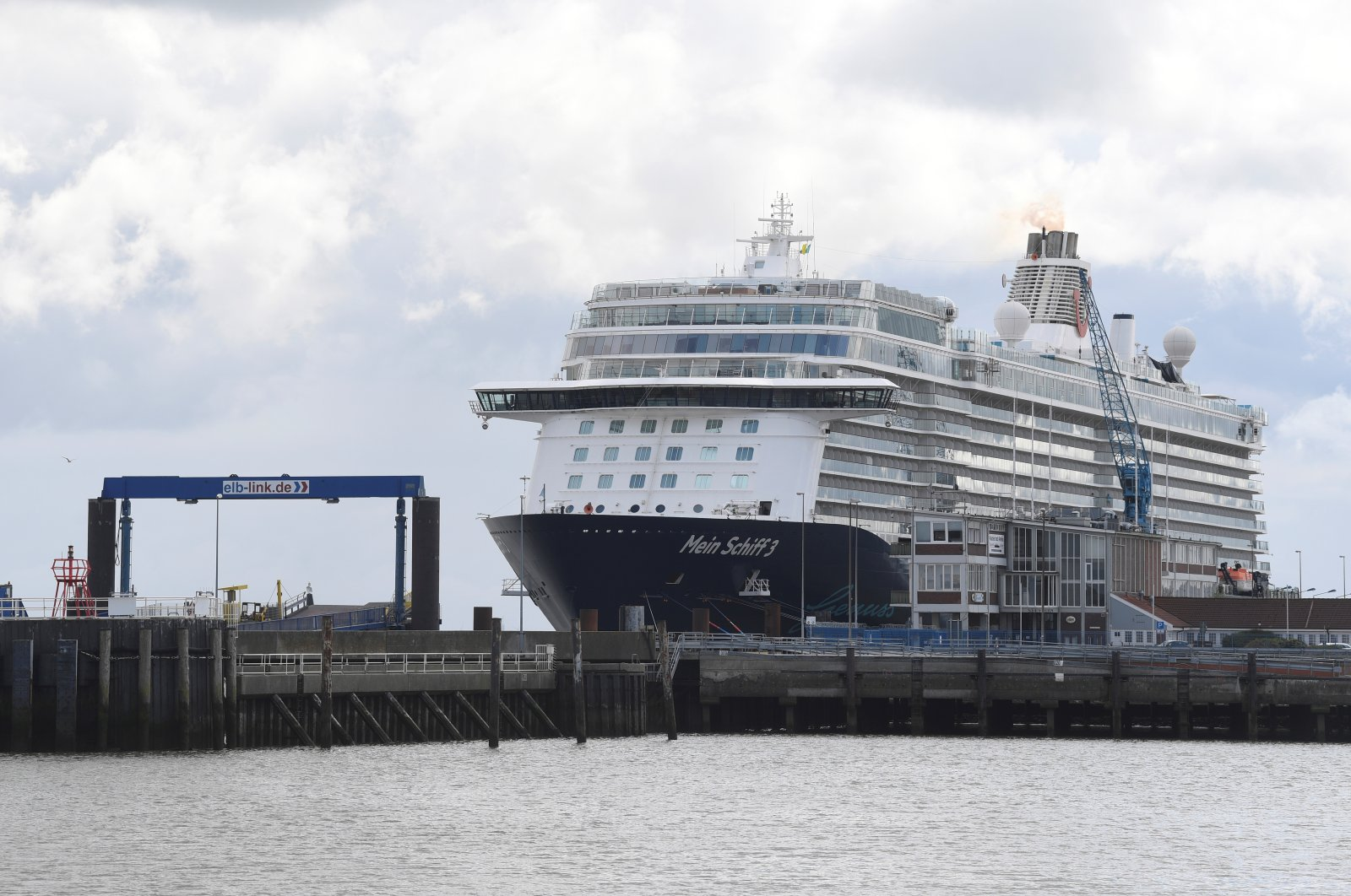 Cruise ship Mein Schiff 3 sits in the harbor with nearly 3,000 travel agency TUI staff members quarantined onboard, according to local media, during the coronavirus pandemic, Cuxhaven, Germany, May 2, 2020. (Reuters Photo)