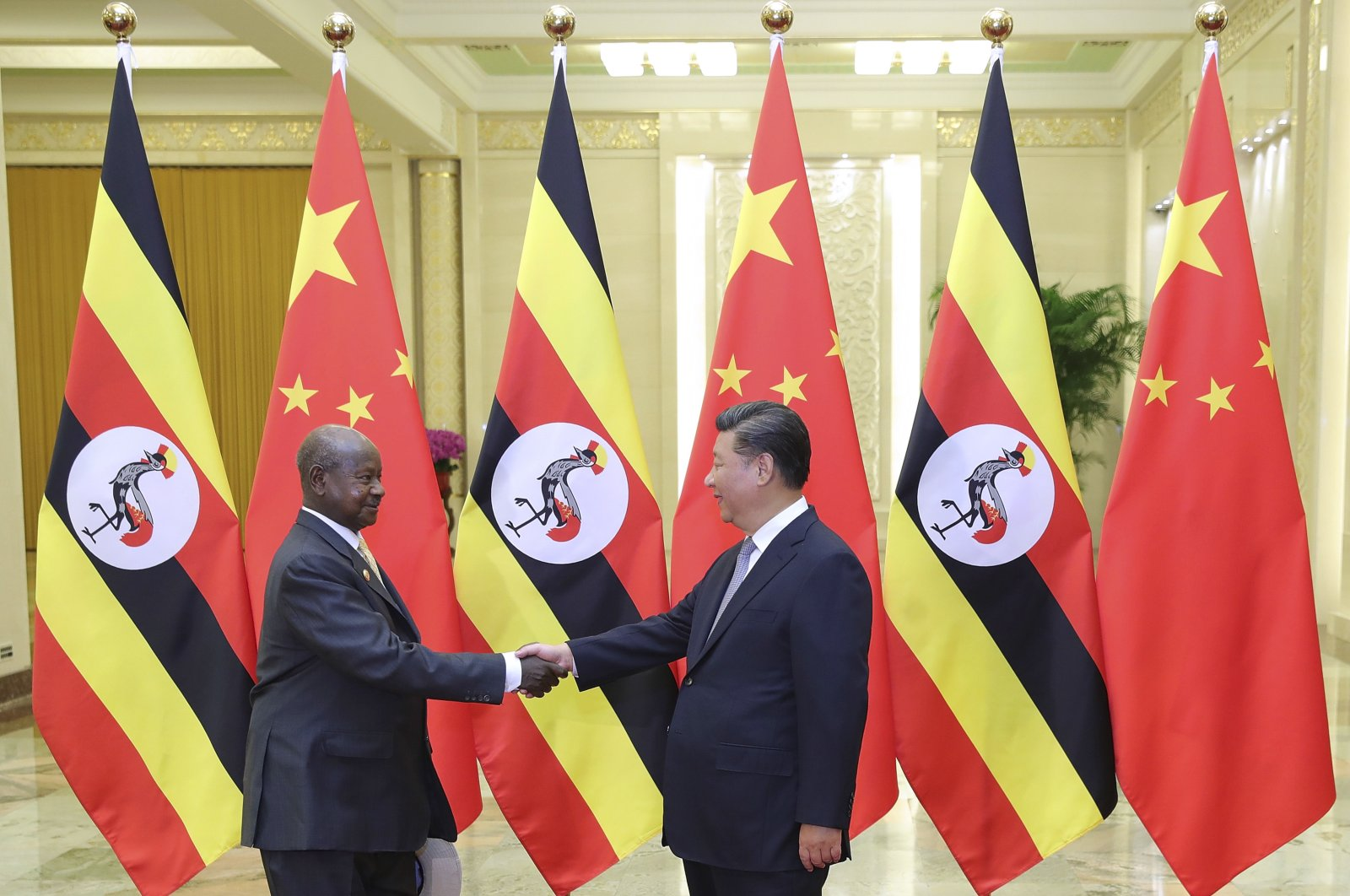China's President Xi Jinping, right, shakes hands with Uganda's President Yoweri Museveni at the Great Hall of the People in Beijing, China, Sept. 6, 2018. (AP Photo)