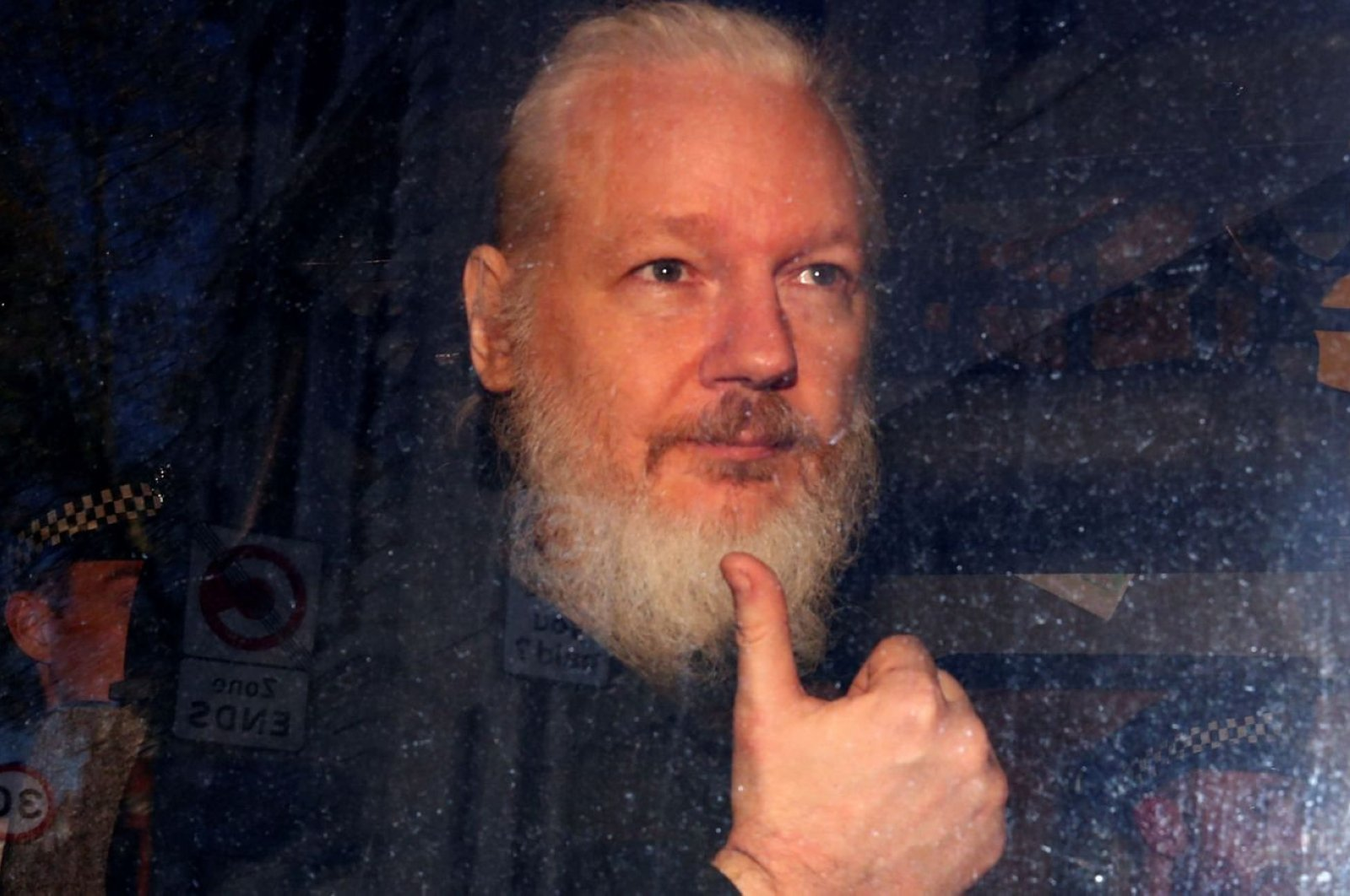 Julian Assange gestures as he arrives at Westminster Magistrates' Court, London, Britain, April 11, 2019. (AP Photo)