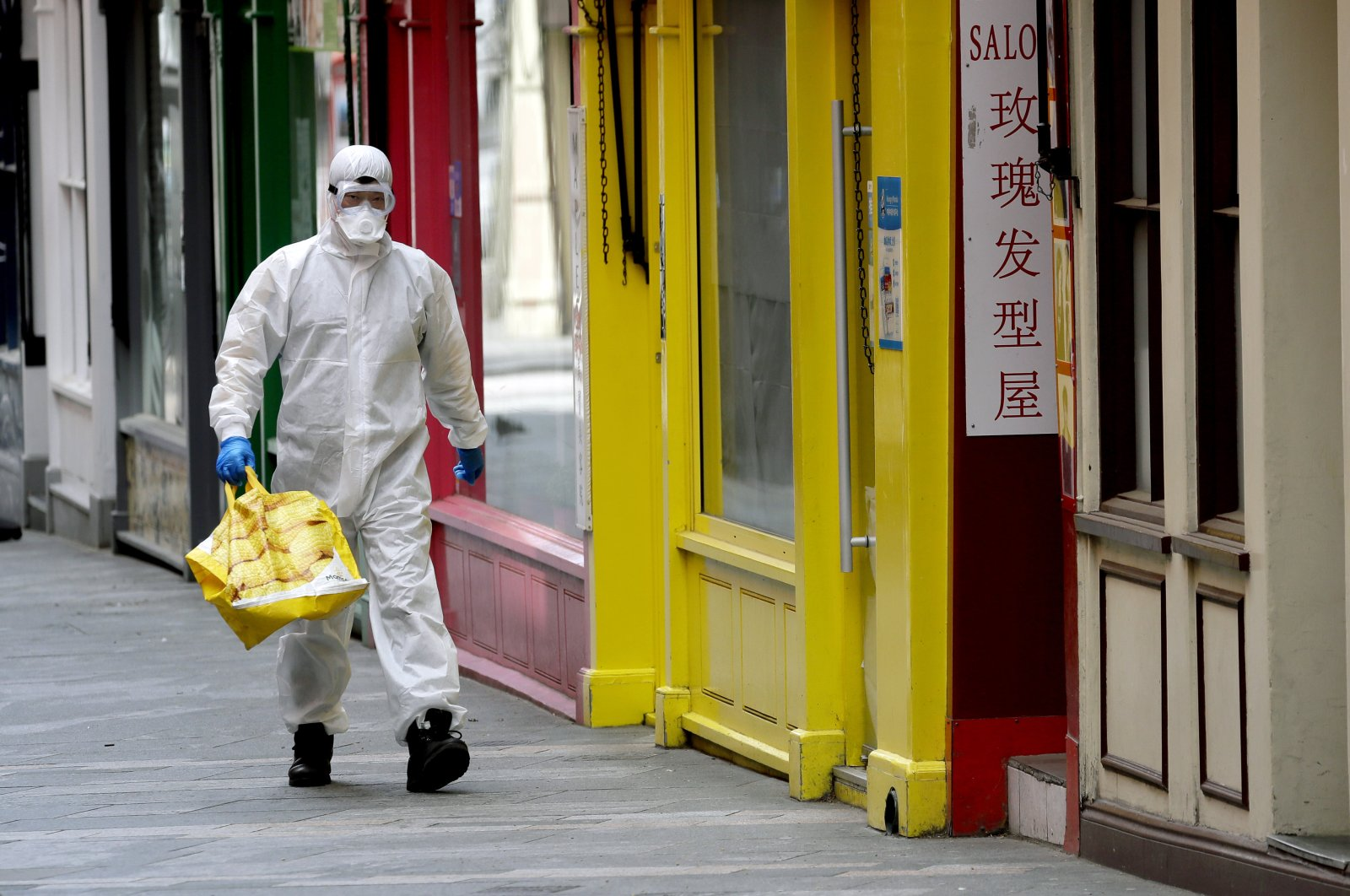 A man wears full protective equipment to protect against the coronavirus as he shops in London, Monday, May 4, 2020, as the UK enters a seventh week of lockdown to help stop the spread of coronavirus. (AP Photo)
