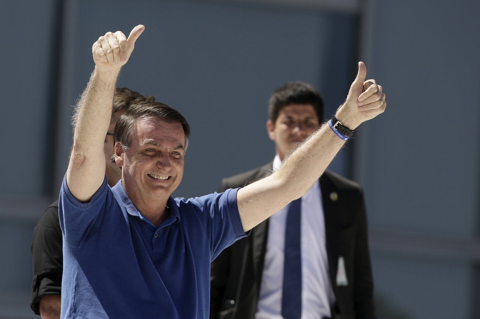 Brazil's President Jair Bolsonaro signals thumbs up to his supporters during a protest against his former Minister of Justice Sergio Moro and the Supreme Court, in front of the Planalto presidential palace, in Brasilia, Brazil, Sunday, May 3, 2020. (AP Photo)