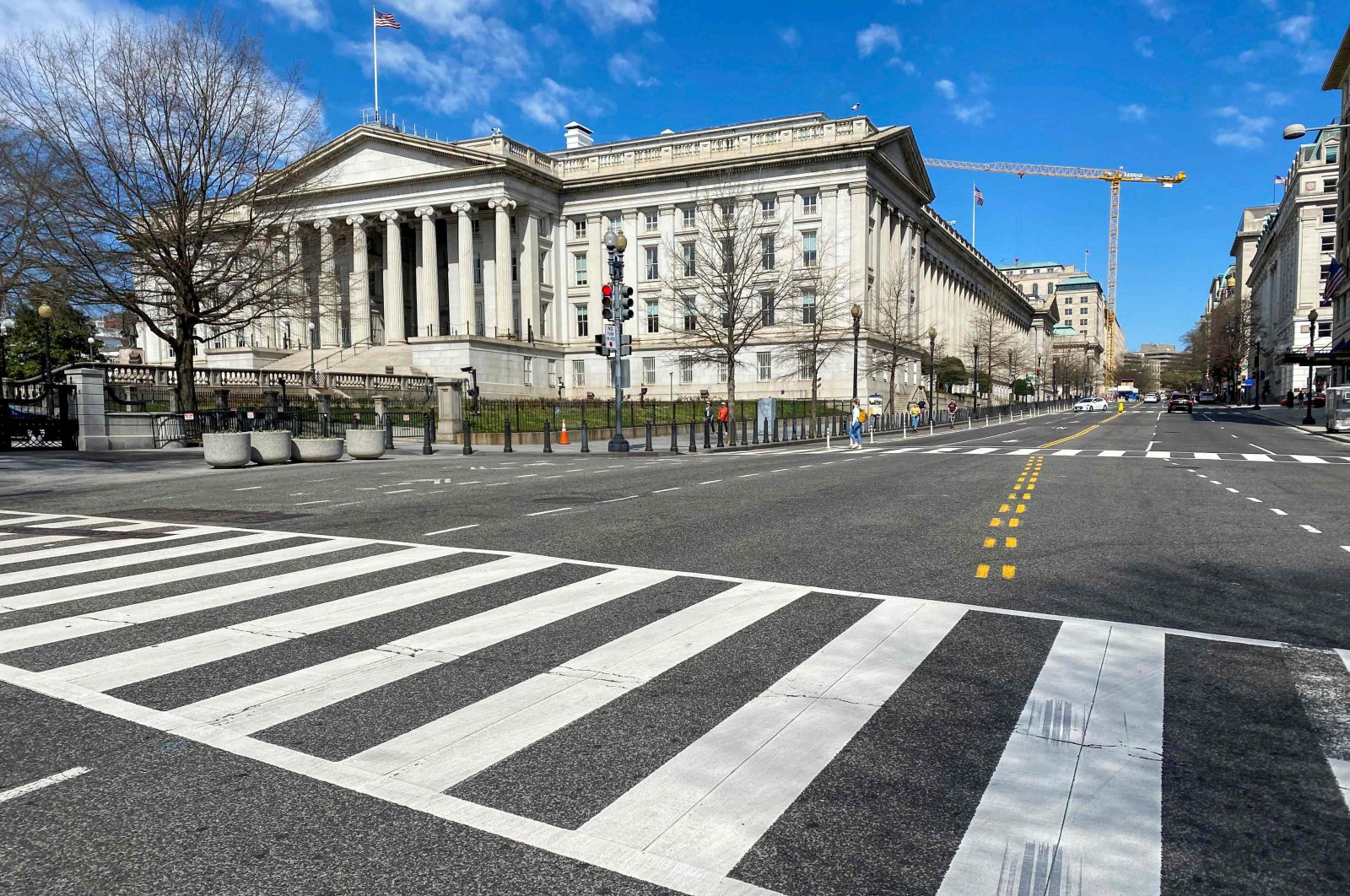 The U.S. Treasury Department building is seen next to an almost empty 15th Street at noon in Washington, March 13, 2020. (AFP Photo)