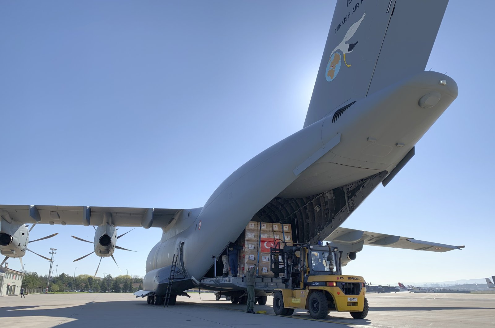 In this handout photo provided by the Turkish Defense Ministry, Turkish soldiers prepare to load a military cargo plane with Personal Protection Equipment donated by Turkey to help United States combat the new coronavirus outbreak, at the Etimesgut airport outside Ankara, Turkey, Tuesday, April 28, 2020. (AP File Photo)
