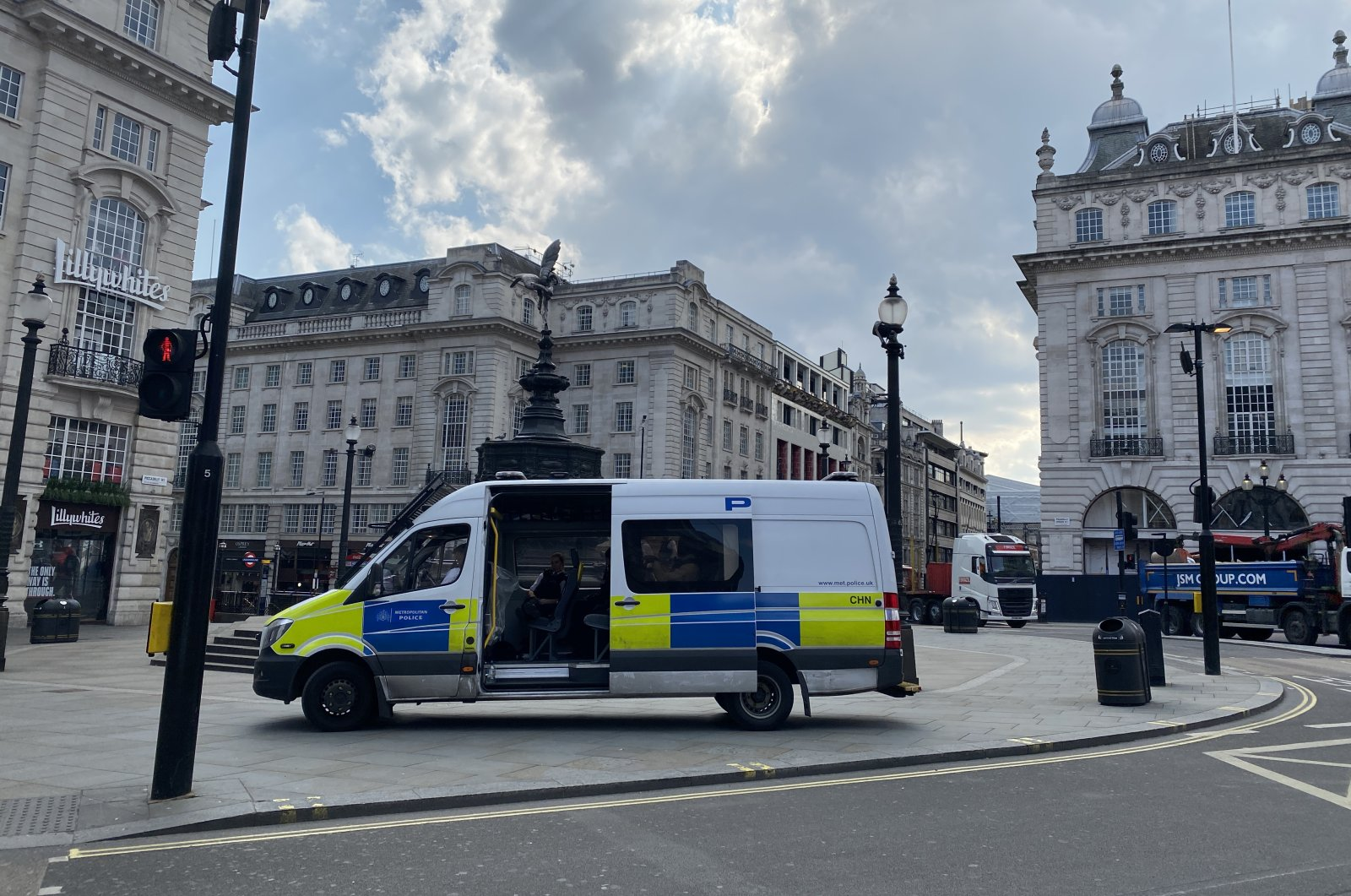 Police teams ensure London's normally crowded Piccadilly Circus remains crowd-free in light of pandemic measures, May 4, 2020 (AA Photo)