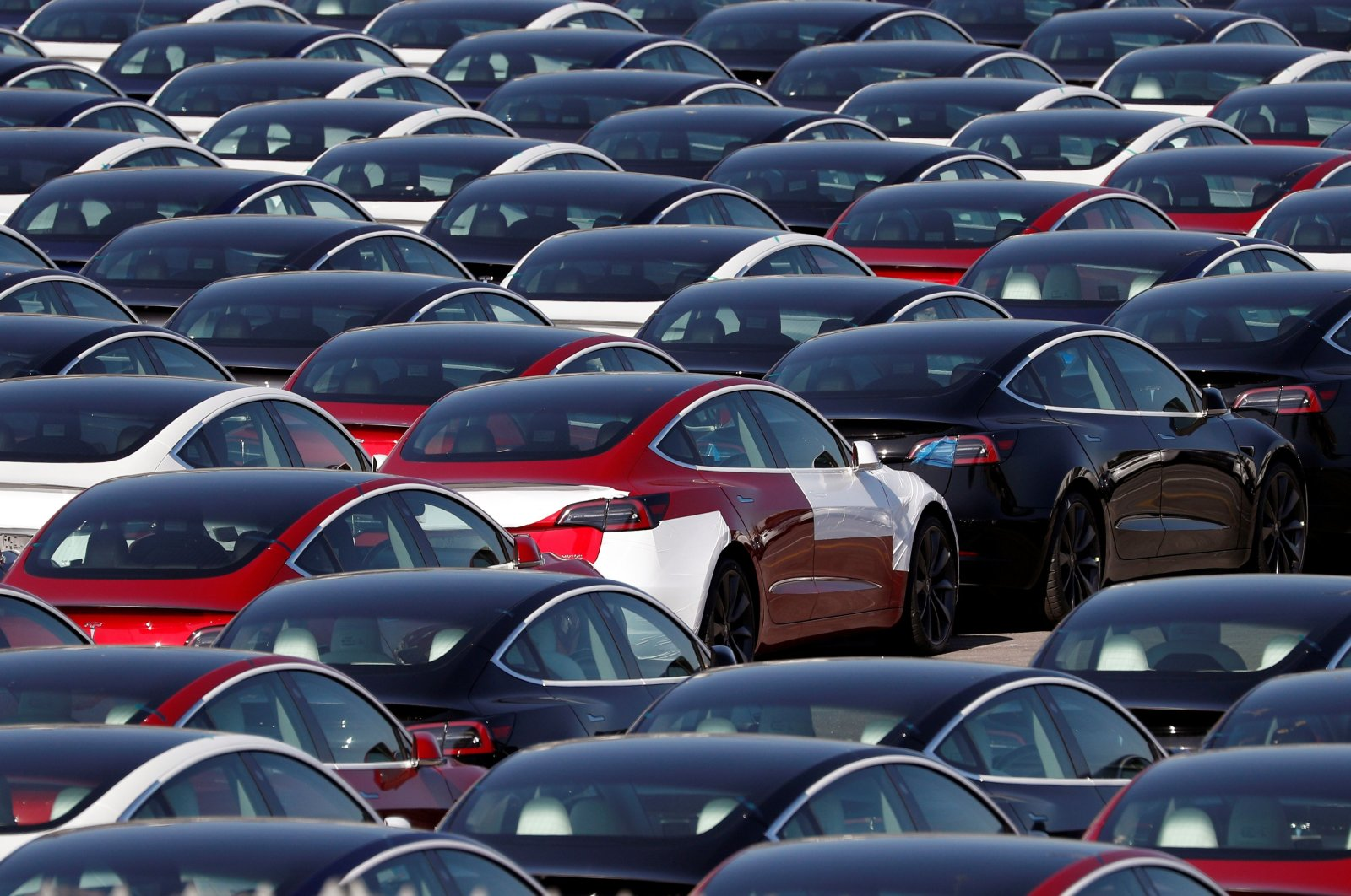 Newly manufactured Tesla electric cars are pictured in a storage area at The Western Docks during coronavirus outbreak, Southampton, England, April 20, 2020. (AFP Photo)