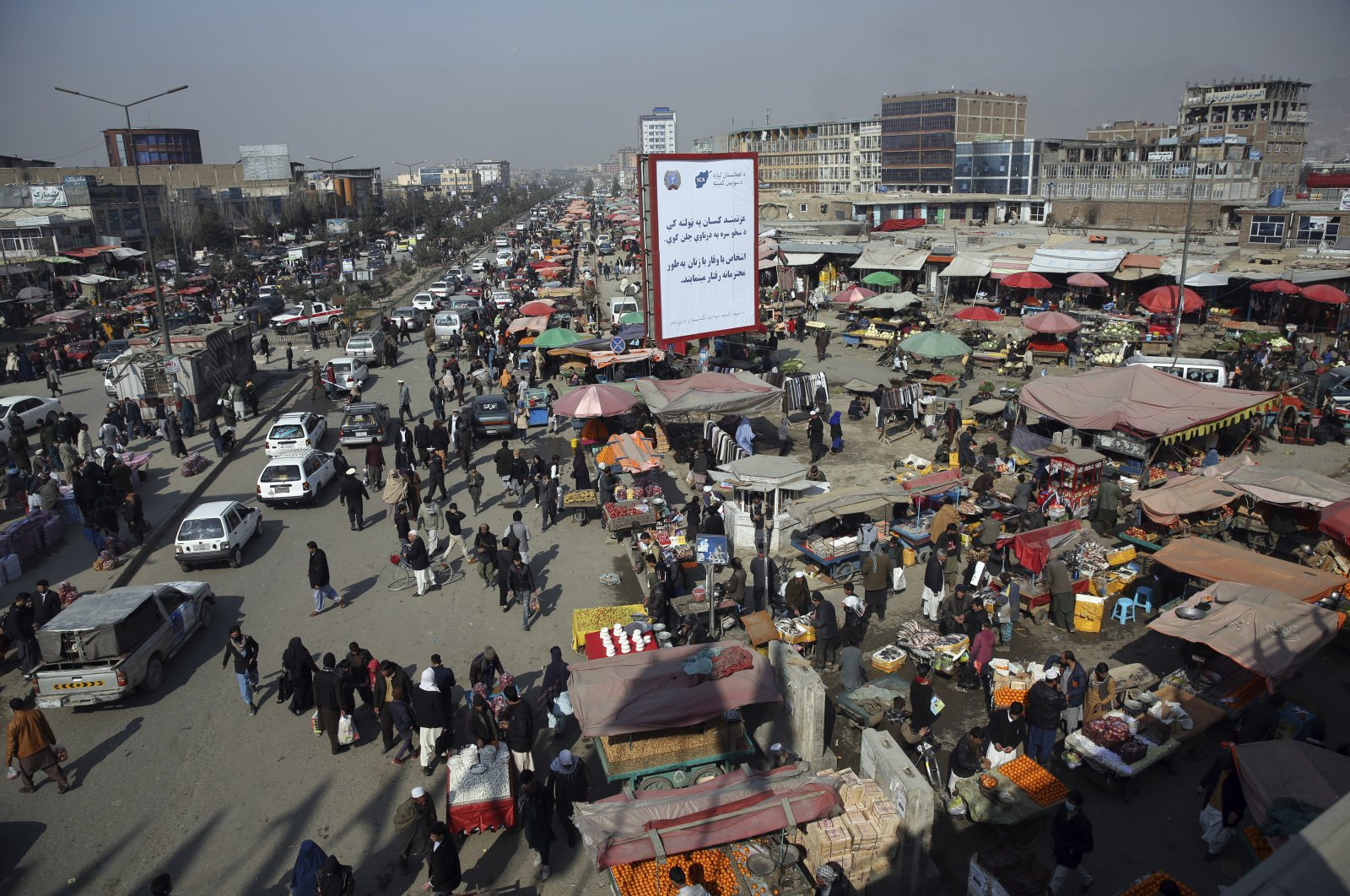 An aerial view looks down on a busy bazaar in Kabul, Afghanistan, Feb. 22, 2020. (AP Photo)