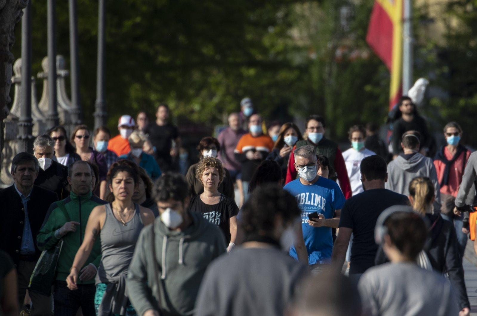 People cross the Toledo bridge in Madrid, Spain, May 3, 2020. (AP Photo)