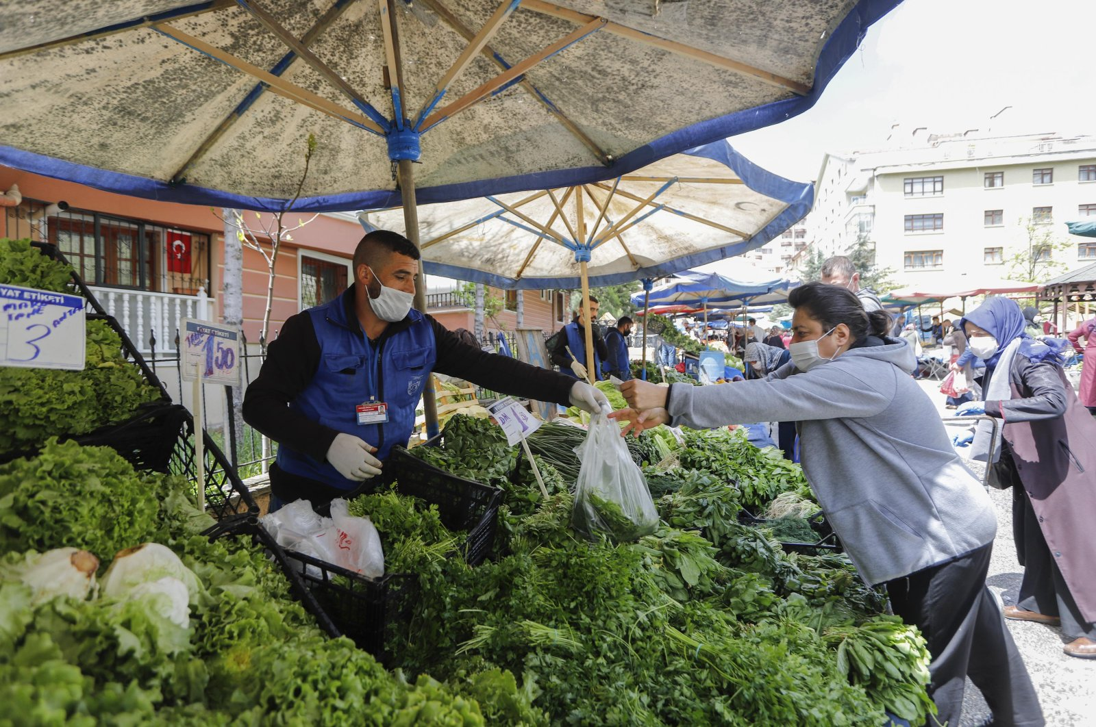 İmdat Kibar, a recovered coronavirus patient, works behind his stall at a marketplace, in Ankara, Turkey, Tuesday, May 5, 2020. (DHA Photo)