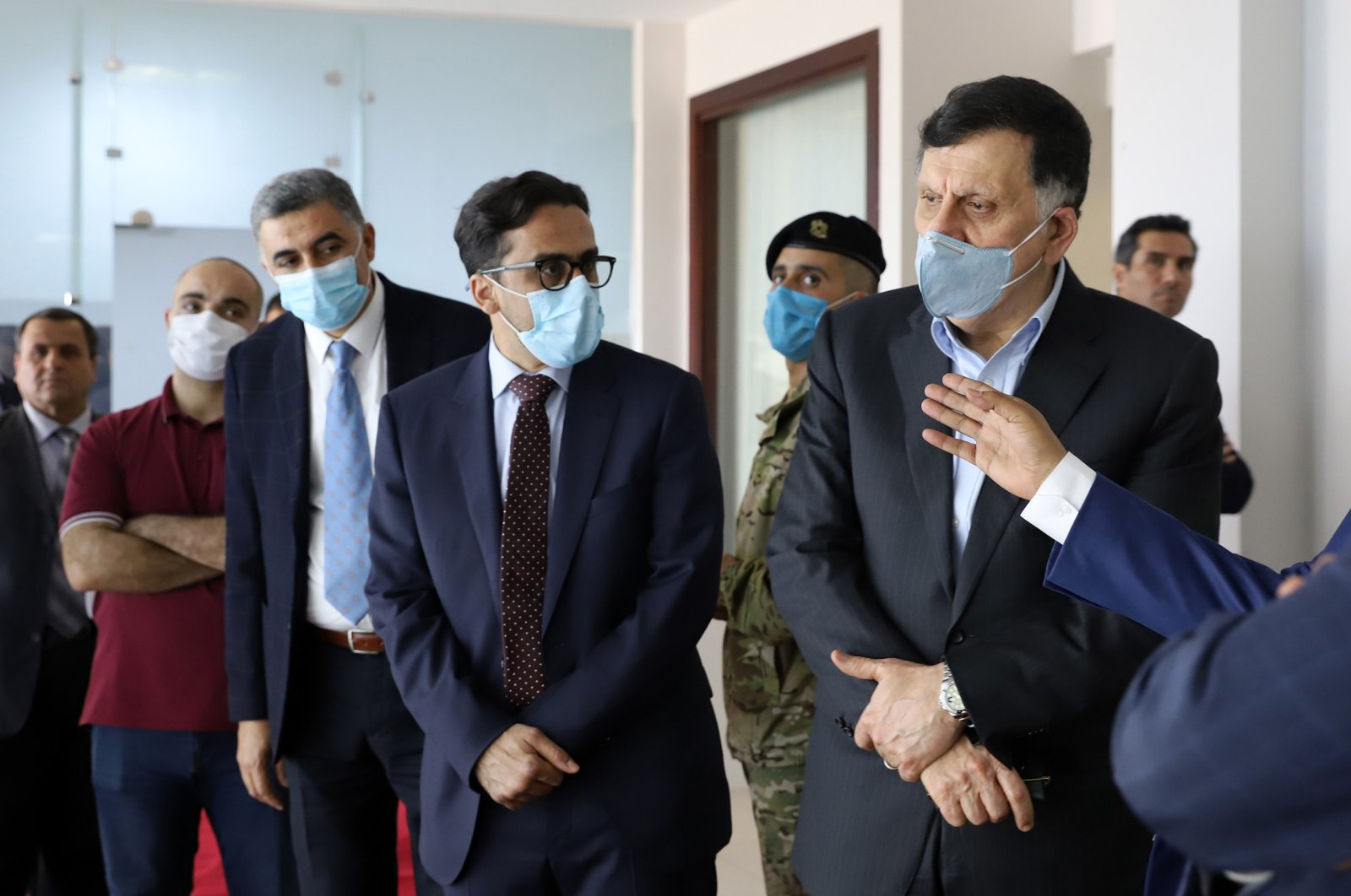 Fayez al-Sarraj (R), prime minister of Libya's U.N.-recognized Government of National Accord (GNA), visits a COVID-19 response center in the capital Tripoli, Libya, May 4, 2020. (AFP Photo )