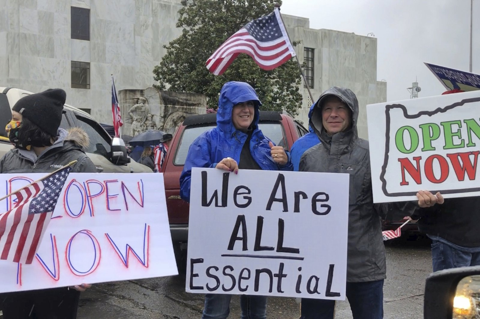 People hold signs protesting Oregon Gov. Kate Brown's executive order that shut down much of the state's economy and imposed social distancing, in her effort to stem the spread of the coronavirus, rally outside the Oregon State Capitol in Salem, Ore., May 2, 2020. (AP Photo)