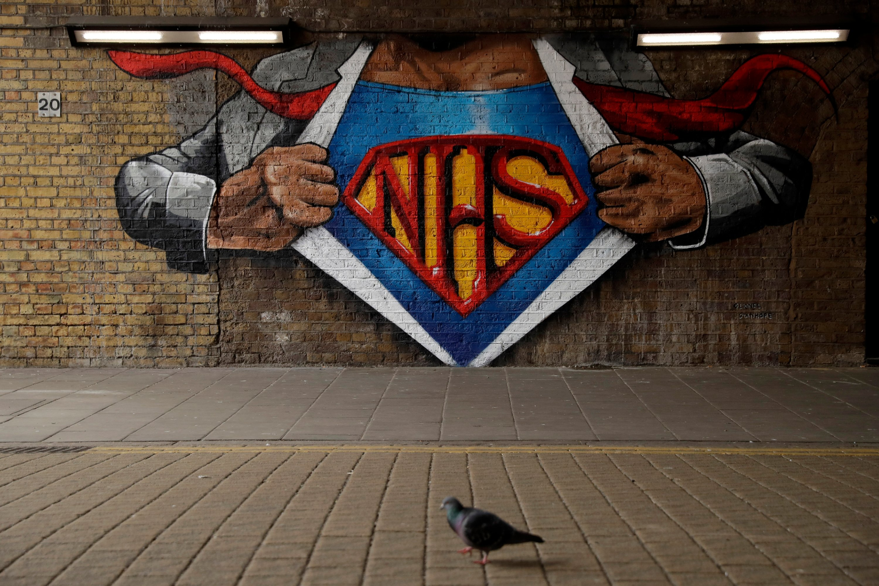 The NHS (National Health Service) Superman design mural by street artist Lionel Stanhope during the coronavirus lockdown, in the Waterloo area of London, Britain, May 3, 2020. (AP Photo)