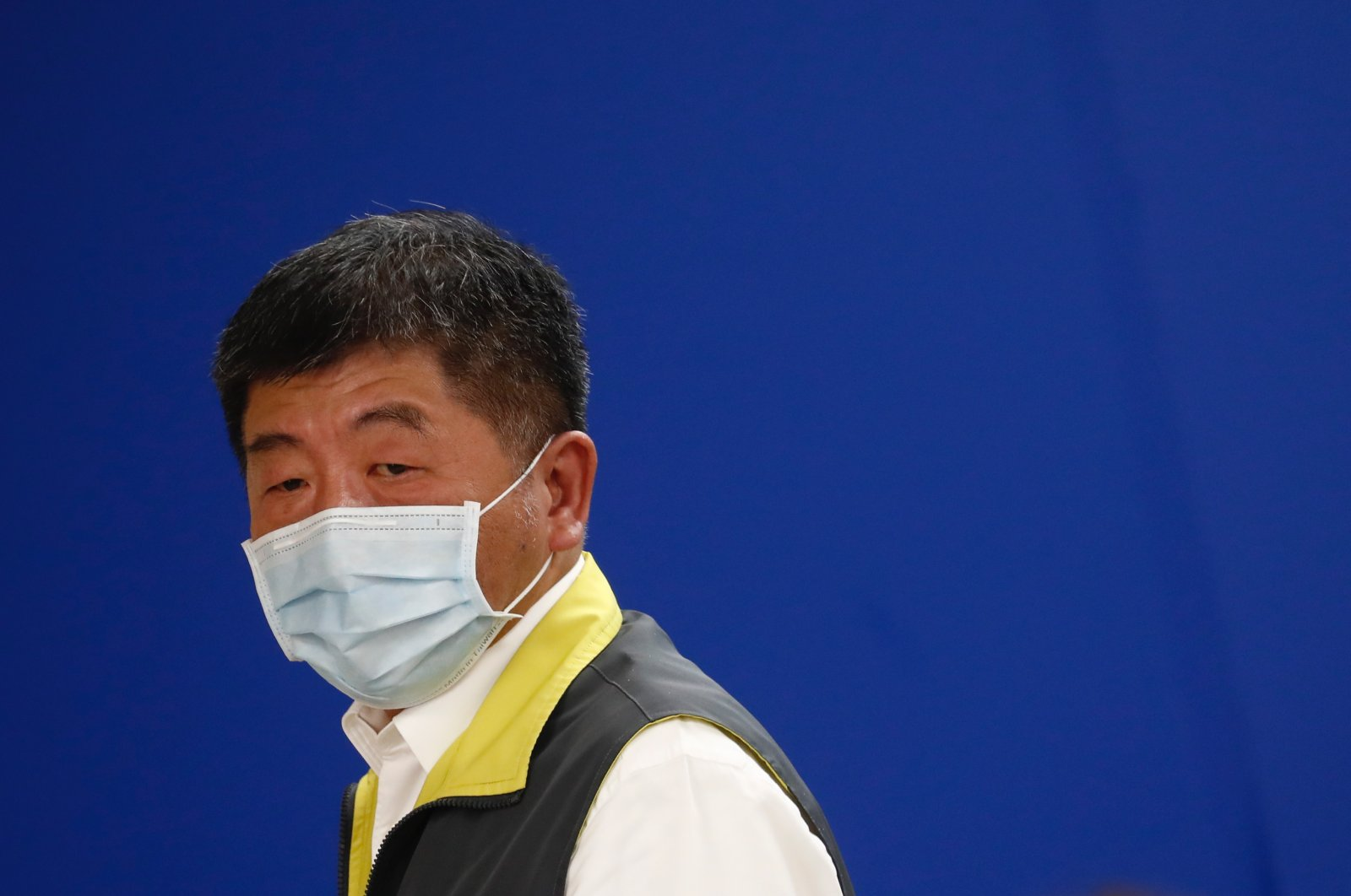 Taiwan Minister of Health and Welfare Chen Shih-Chung leaves after speaking during a press briefing with foreign journalists about the current measures and status in the fight against coronavirus and COVID-19 in Taipei, Taiwan, May 6, 2020. (EPA Photo)