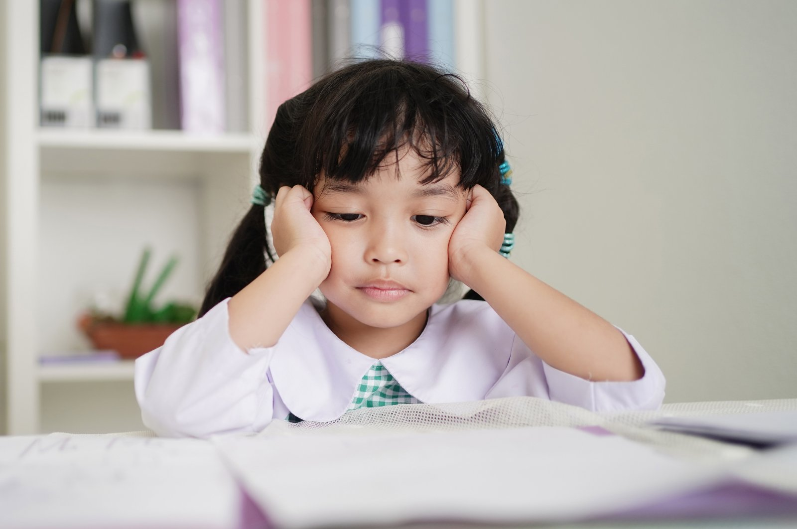 If you catch your child with a frustrated look on their face while studying, try to get them to move around a bit. (Shutterstock Photo)