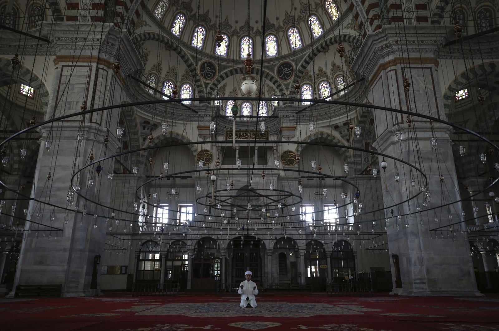 Esat Şahin, imam of the iconic Fatih Mosque, holds prayers on the first day of Ramadan without the public due to the coronavirus restrictions in Istanbul, Turkey, April 24, 2020. (AP Photo)