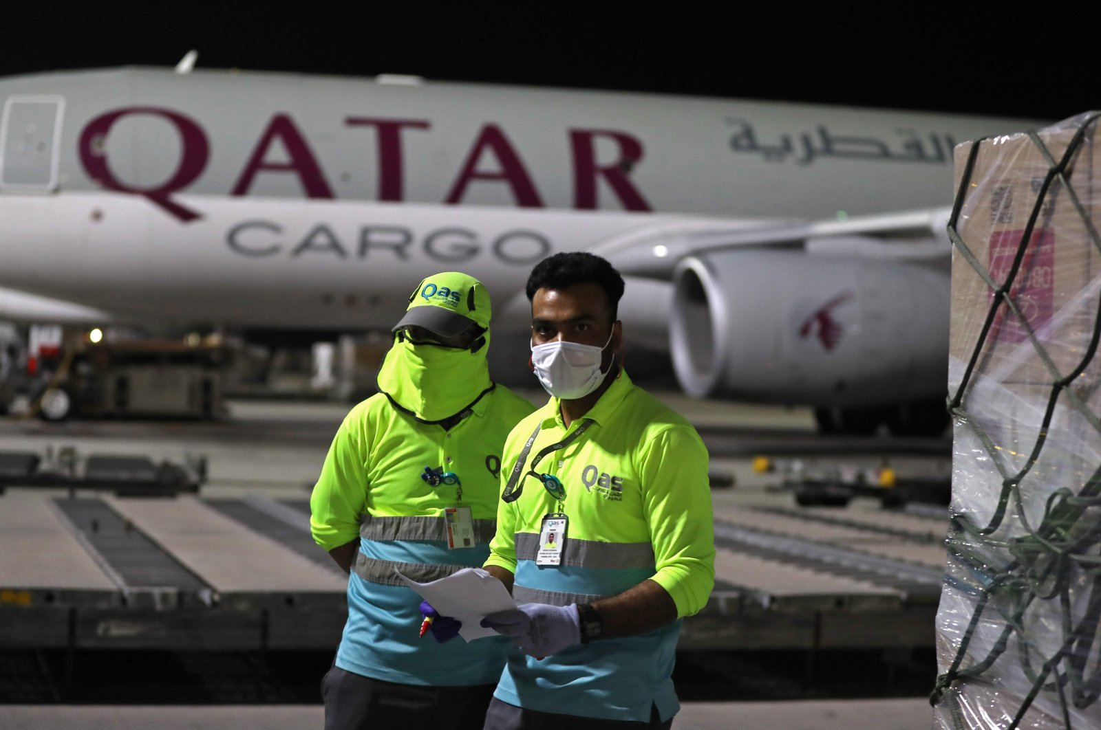 Supplies to tackle the coronavirus pandemic donated by the Qatar Fund for Development are loaded onto a Qatar Airways flight to Kigali, Rwanda, at Hamad International Airport, Doha, Qatar, April 28, 2020. (AFP Photo)